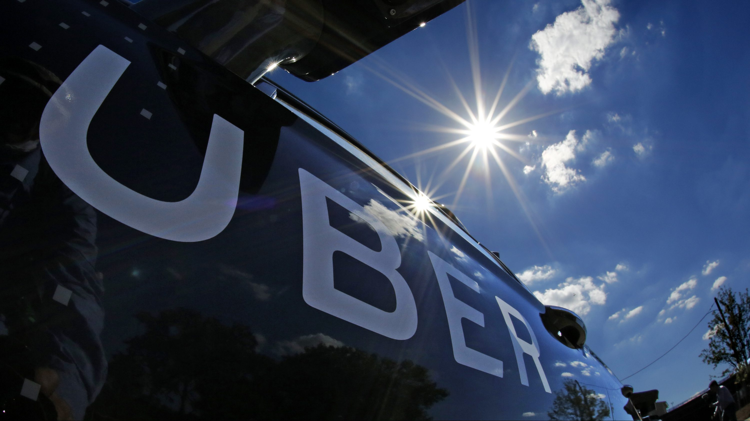 A self driving Uber sits ready to take journalists for a ride during a media preview in Pittsburgh, Monday, Sept. 12, 2016. (AP Photo/Gene J. Puskar)