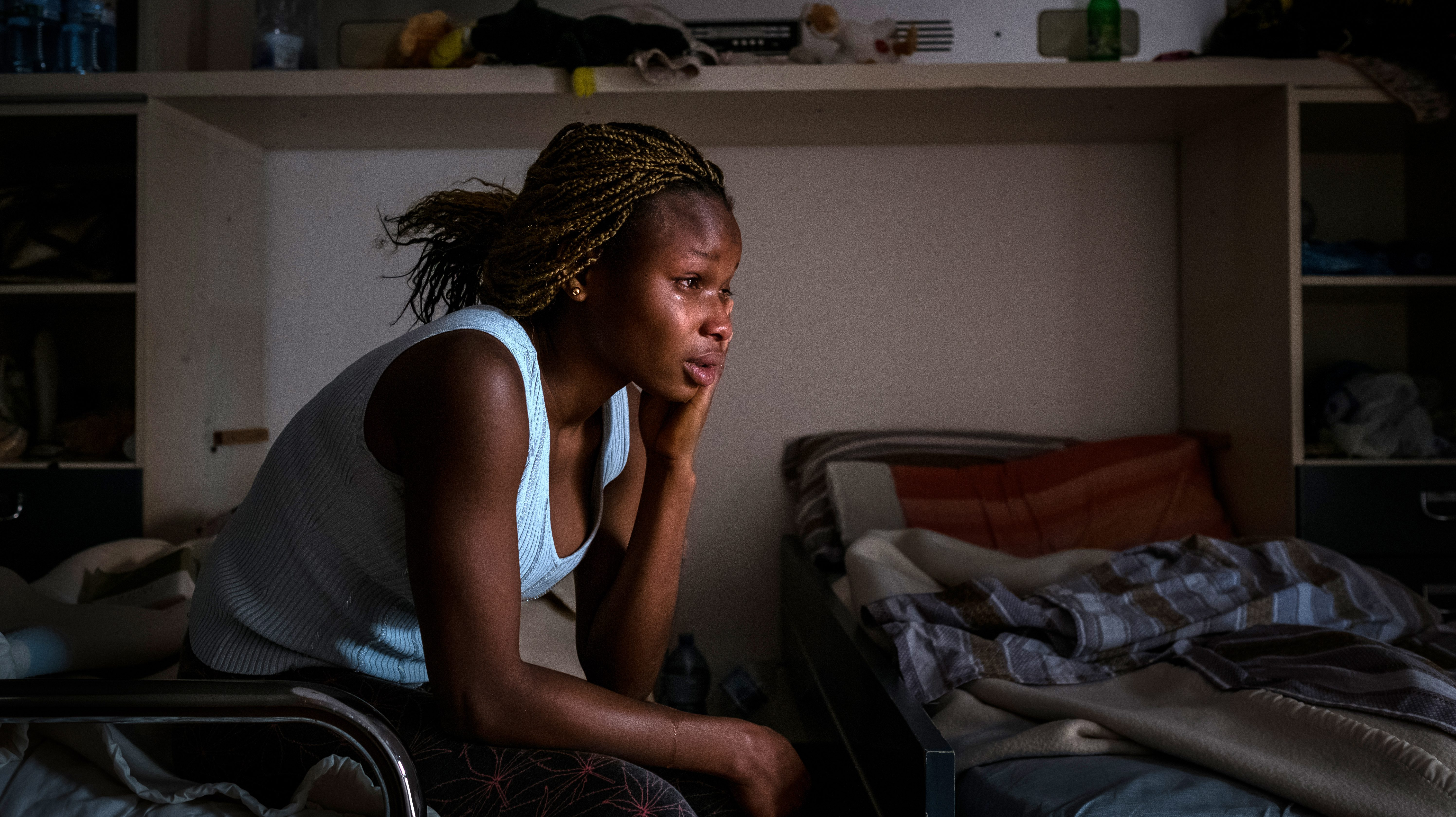"""Mary, 18, from Benin City, Nigeria, at a safe house for victims of sex trafficking run by the Penelope association on the outskirts of Taormina, Sicily, Italy on April 27, 2017. When she was seventeen, Mary escaped a life with no prospects in Nigeria to work in Italy, but was deceived by traffickers into becoming a prostitute. On her journey she was raped by the trafficker, and on arrival in Italy she confessed that knew she was going to be used in the sex trade, giving authorities the opportunity to extract her from the ring.  """"There is no hope in Nigeria,"""" Mary says, """"I suffered a lot there, I don't have anyone to help me. I couldn't go to school. My father is dead to me, I have no siblings, so I had to work as a house girl looking after a woman's babies and cleaning her house. I was so frustrated and didn't know what to do, and my friend said I should go to Europe. I don't have anyone to rely on in Nigeria, and I decided to go.""""  """"Though my country is sweet and I love it, I suffered too much. There was no future there for me. A woman said she would help me and send me to Europe and she introduced me to a man, his name is Ben, who she said could help me. Ben said he knew people who had restaurants to put me to work in. For the moment, he said he would pay my expenses.   """"The next day, the man called me to his house."""" Mary says. """"There were lots of boys and girls there. He said to all of us, if we made it to Europe, we all had to each pay €25,000. Some people said no, but I said that was okay.""""   """"Then he took us to a place they do juju.""""  Juju is an ancient Nigerian belief system in the occult and through witches, spells are be cast on girls to ensure they fear for their lives should they escape.  """"We had to swear to an old woman –a sorcerer– that we wouldn't run."""" Mary explains.  """"So, on March 17, I left for Libya. That place is very very bad. They treated us so"""