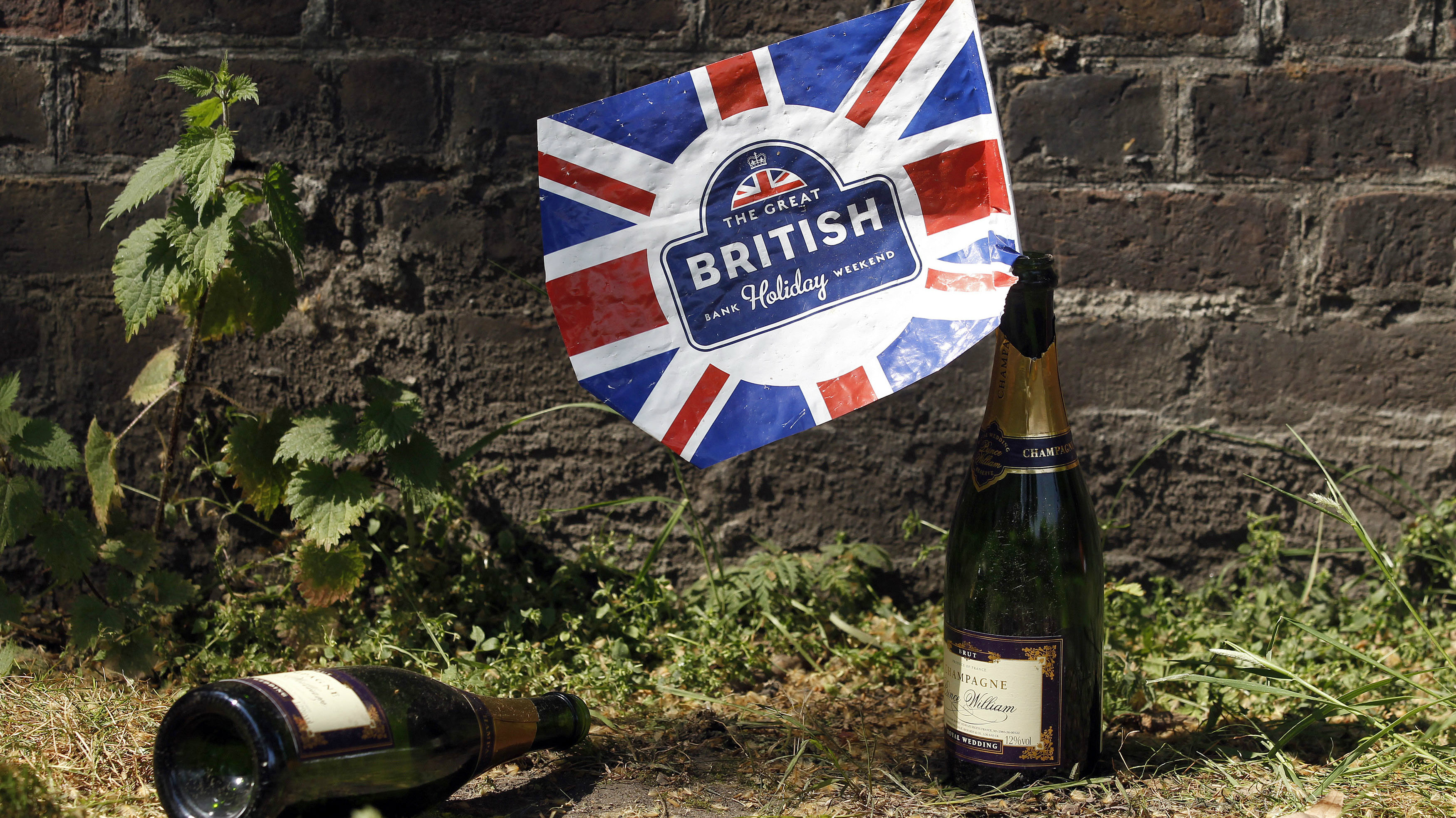 Champagne bottles by a union Jack flag