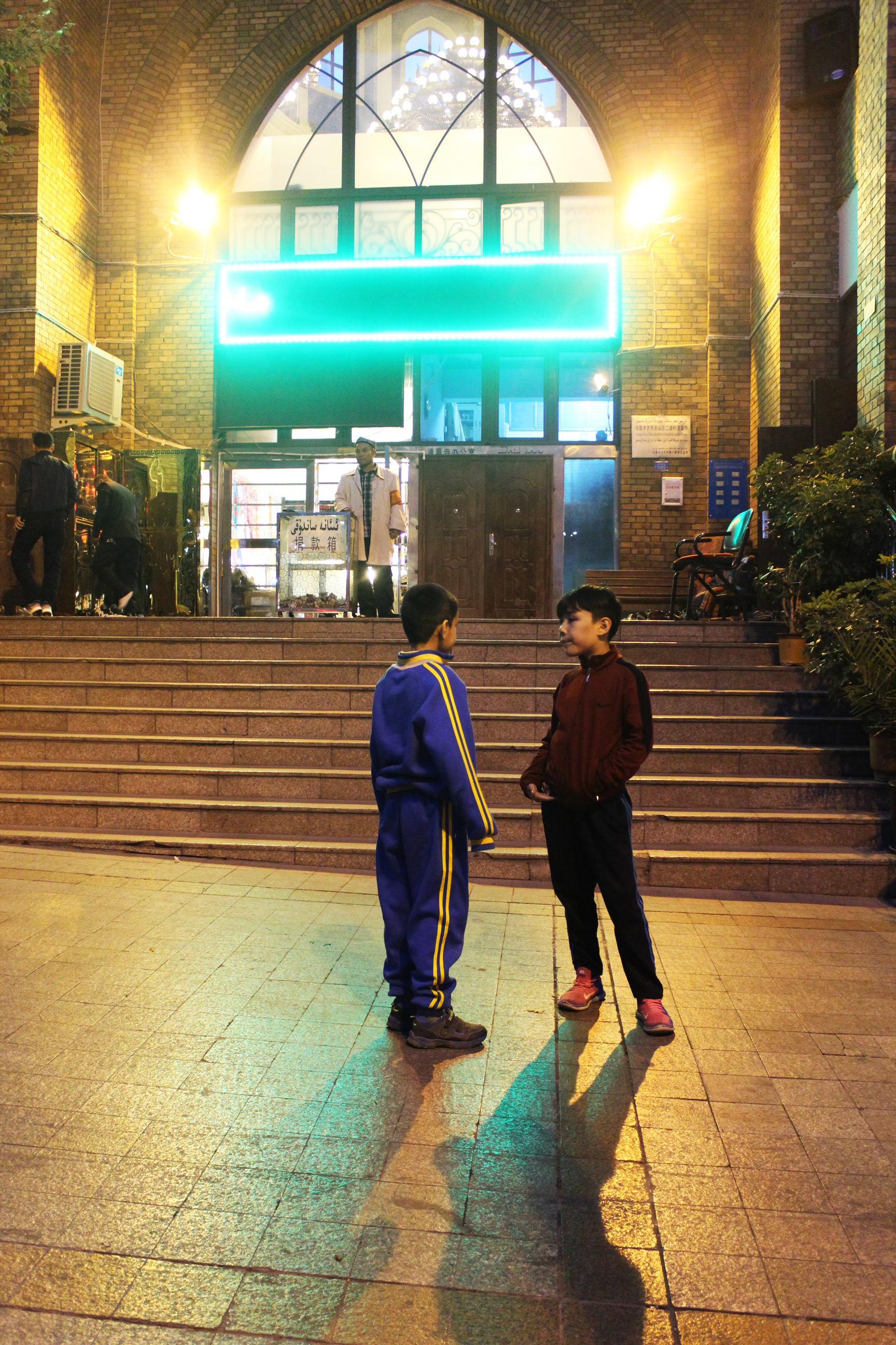 Outside a mosque in Urumqi, China.