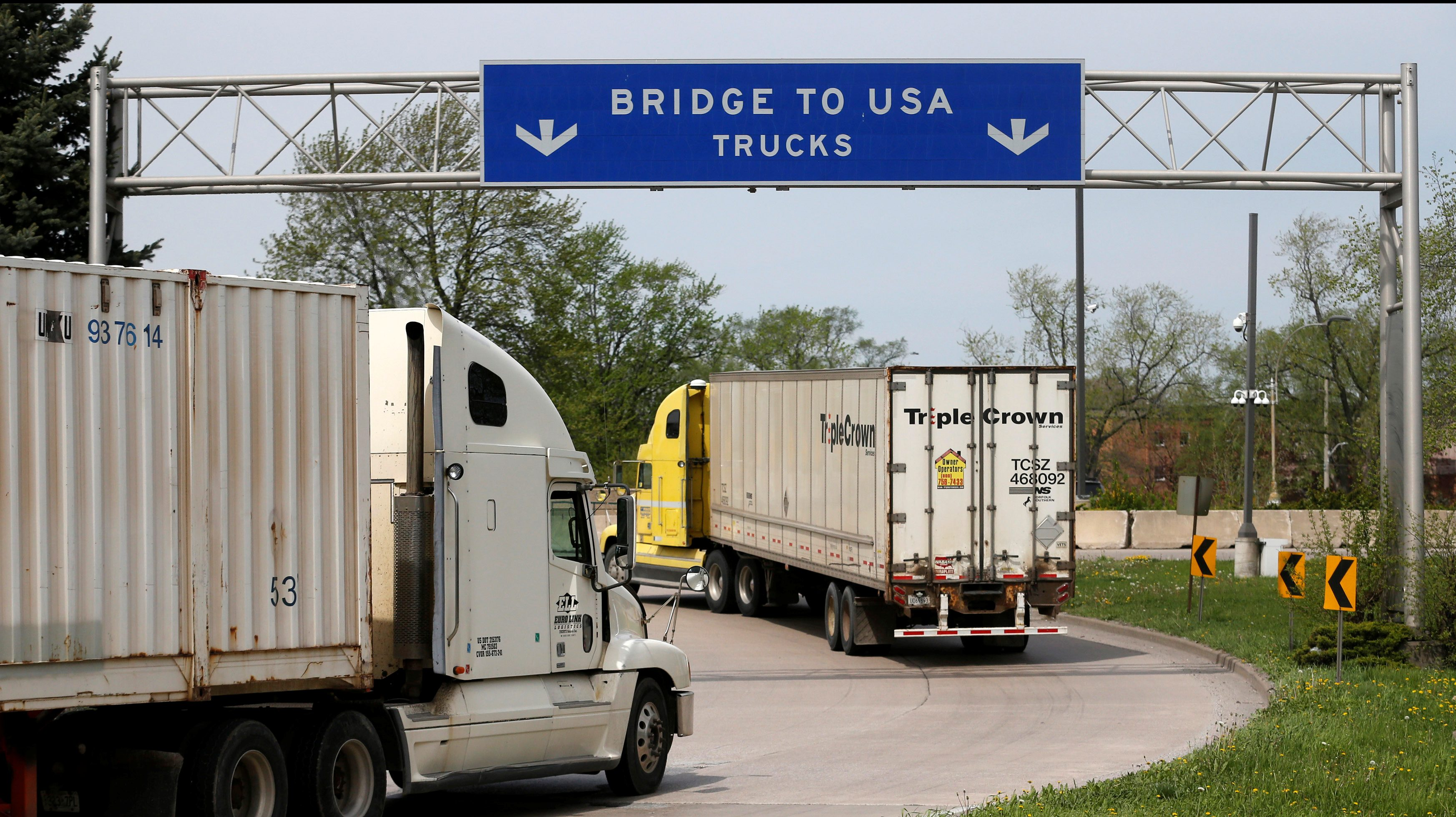 Semi trucks heading for the US from Canada