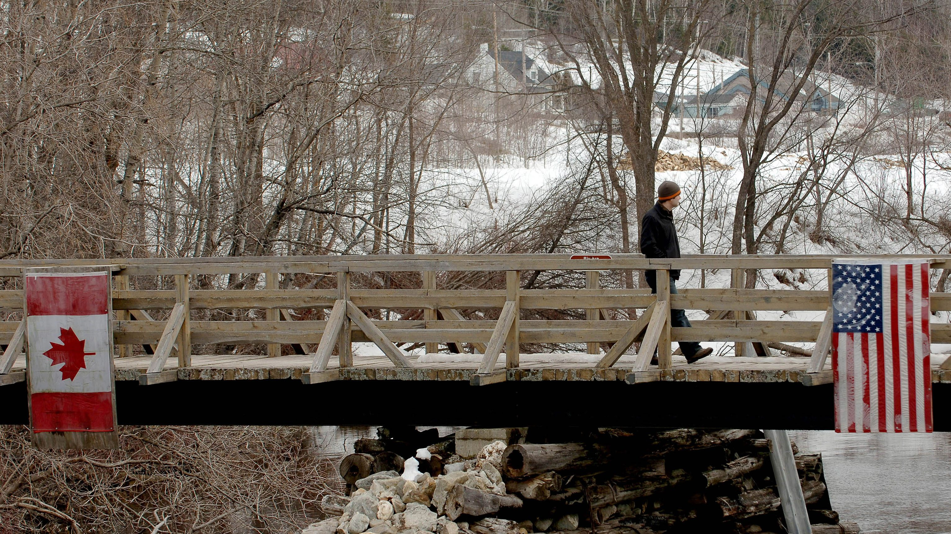 A pedestrian crosses into the US from Canada