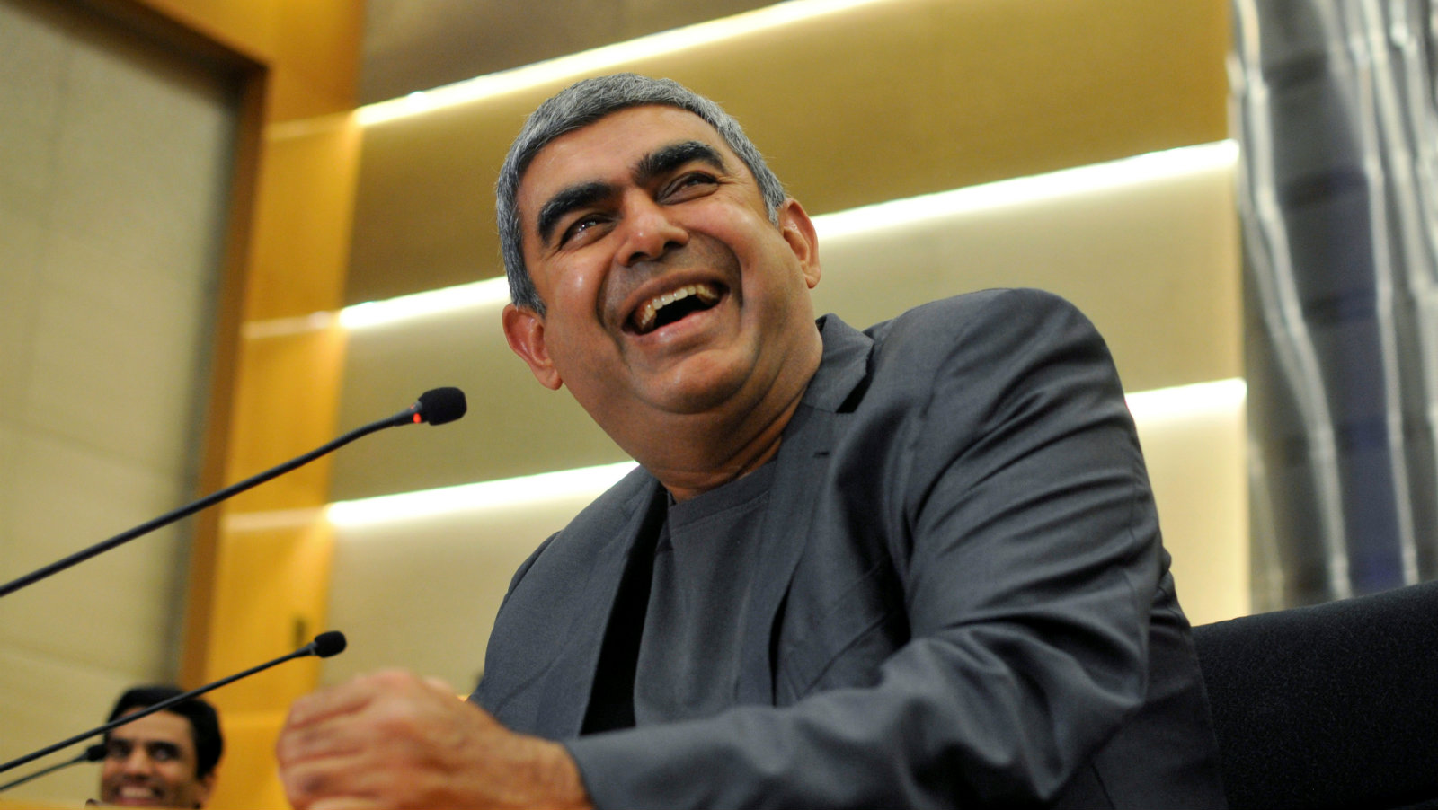 Infosys Chief Executive Vishal Sikka laughs during the announcement of the company's quarter results at its headquarters in Bengaluru, India, April 15, 2016. India's second-largest IT services firm Infosys forecast strong revenue growth and reported its third successive estimate-beating earnings on new client wins, solidifying a recovery that began a year ago under its new chief executive.