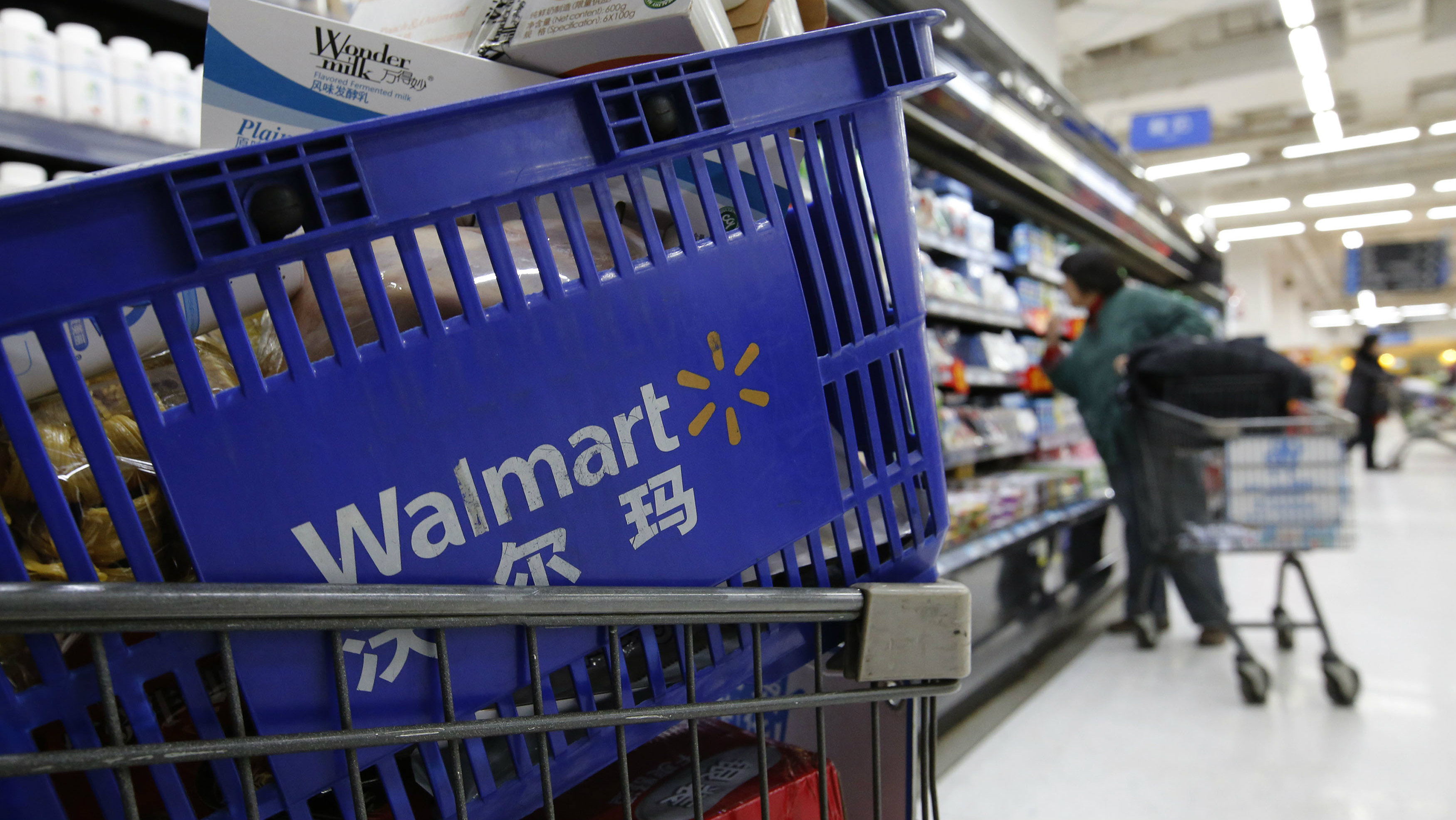A shopping cart full of products is seen as a customer shops at a Wal-Mart store in Beijing, February 18, 2014. Wal-Mart Stores Inc, famed for its low prices, has stumbled in the one major market where consumers say price is less of a driver in their buying decisions: China. There, consumers say they want food that is safe and authentic, and, after 17 years, Wal-Mart is changing its approach, closing some big-box stores that never quite caught on with locals. Instead, it's focusing on private-label products and imports, putting its stamp on quality and safety. Picture taken February 18, 2014.