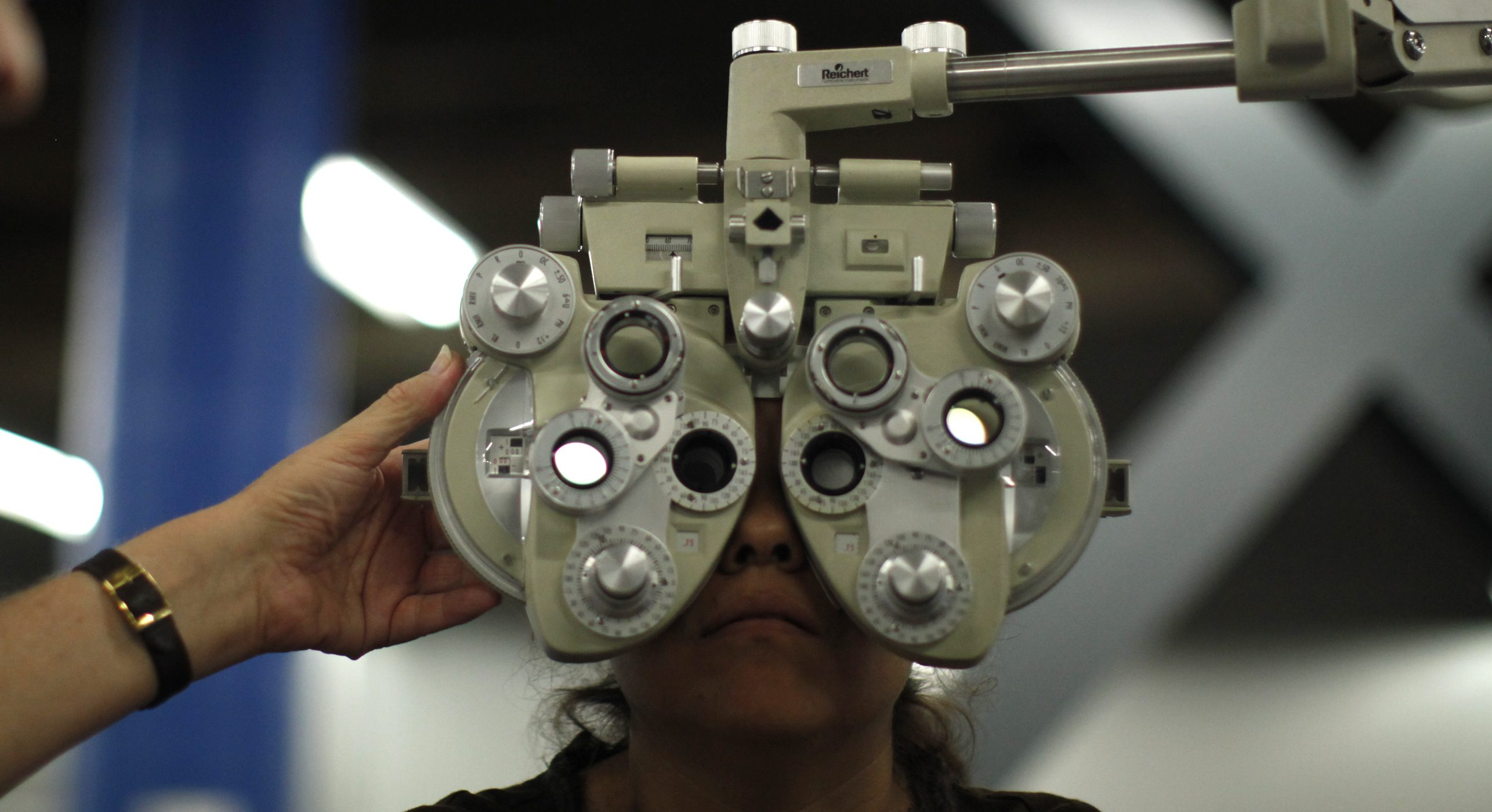 A woman receives an eye exam at the Care Harbor/LA free clinic in Los Angeles September 27, 2012.