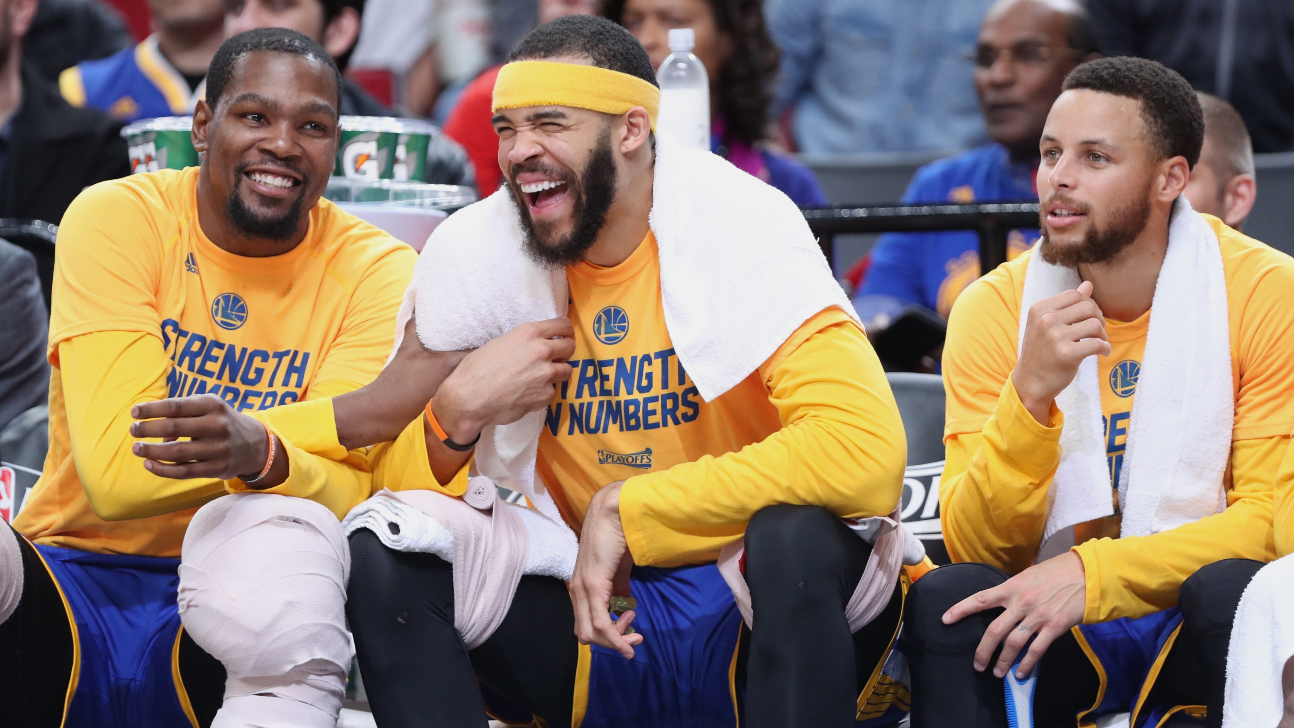 Golden State Warriors forward Kevin Durant (35) and center JaVale McGee (1) and guard Stephen Curry (30) react in the closing the seconds of a 128-103 win over the Portland Trail Blazers to clinch game four of the first round of the 2017 NBA Playoffs at Moda Center.