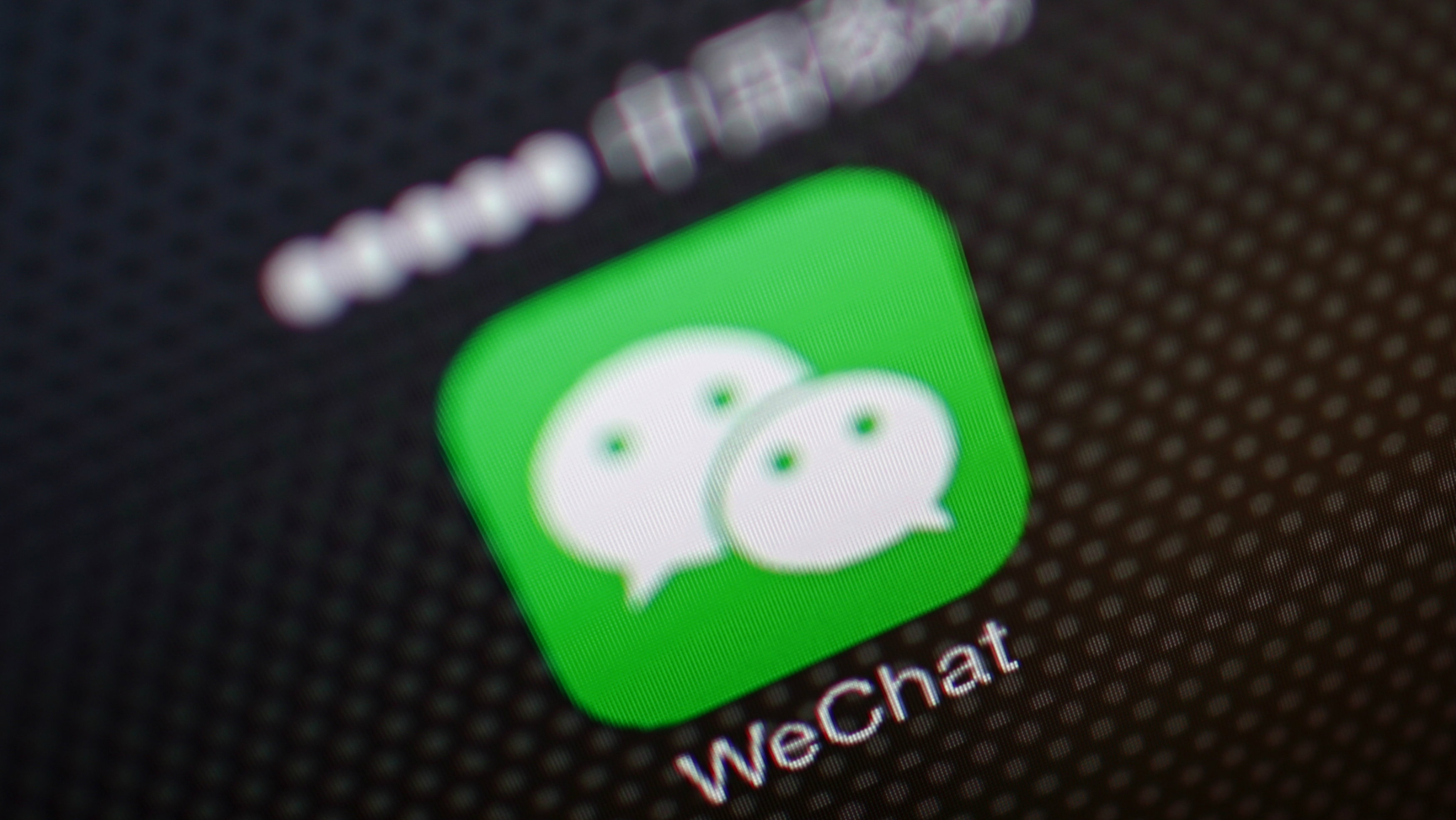 """A picture illustration shows a WeChat app icon in Beijing, December 5, 2013. An unprecedented Nov. 14 leak of China's Communist Party reform plans fuelled China's biggest stock market rally in two months as it spread on microblogs and passed from smartphone to smartphone on WeChat, a three-year-old social messaging app developed by Tencent Holdings Ltd. WeChat, or Weixin in Chinese, meaning """"micromessage"""", leapt from 121 million global monthly active users at the end of September 2012 to 272 million in just a year. It has quickly become the news source of choice for savvy mobile users in China, where a small army of censors scrub the country's Internet of politically sensitive news and """"harmful"""" speech."""