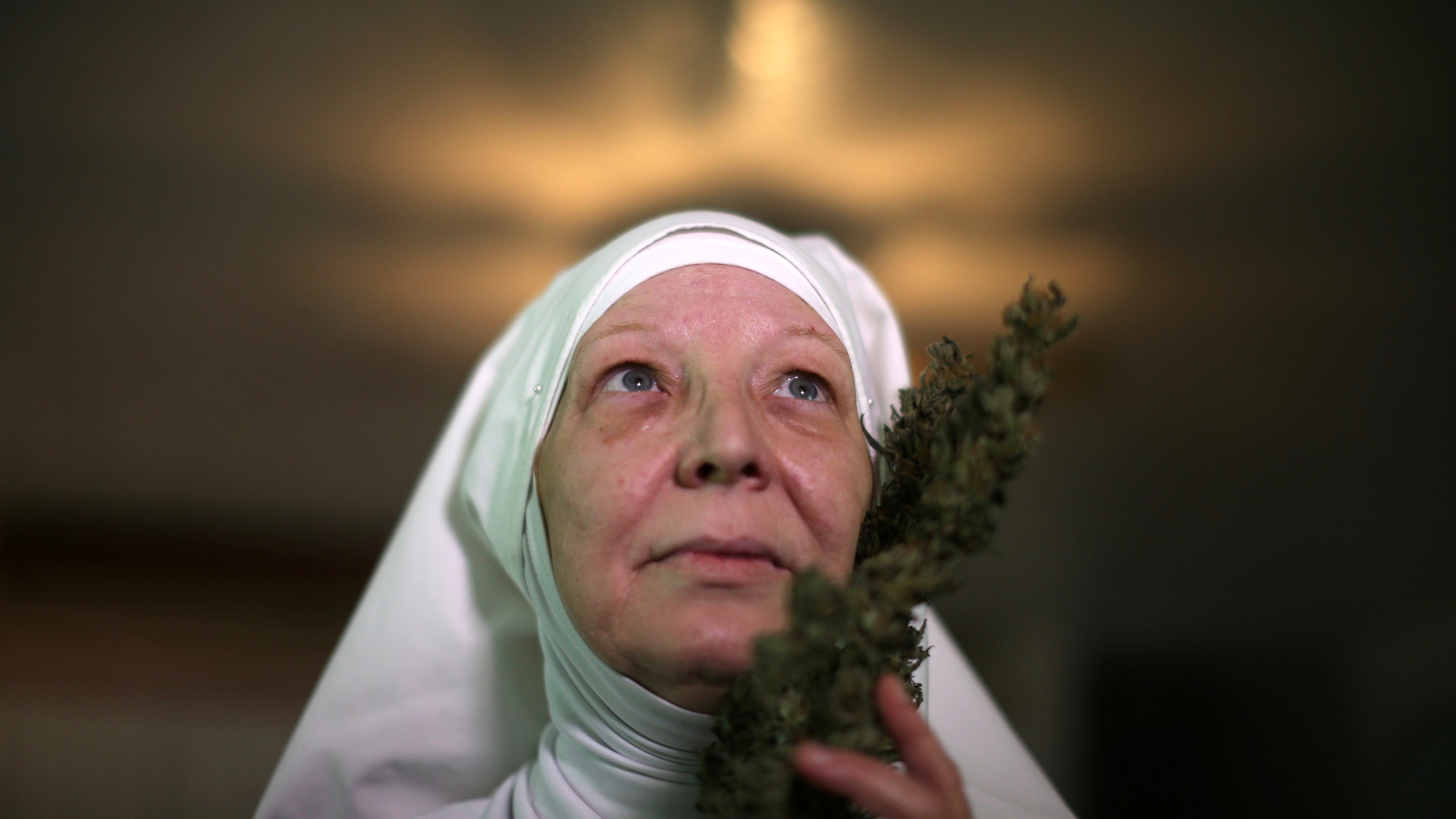 "California ""weed nun"" Christine Meeusen, who goes by the name Sister Kate, poses for a portrait with hemp."