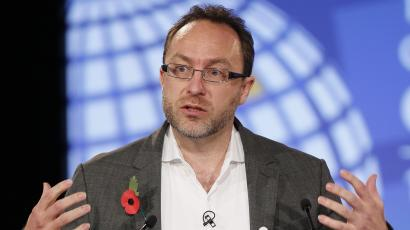 Wikipedia founder Jimmy Wales gestures during the opening session at the London Cyberspace Conference in London