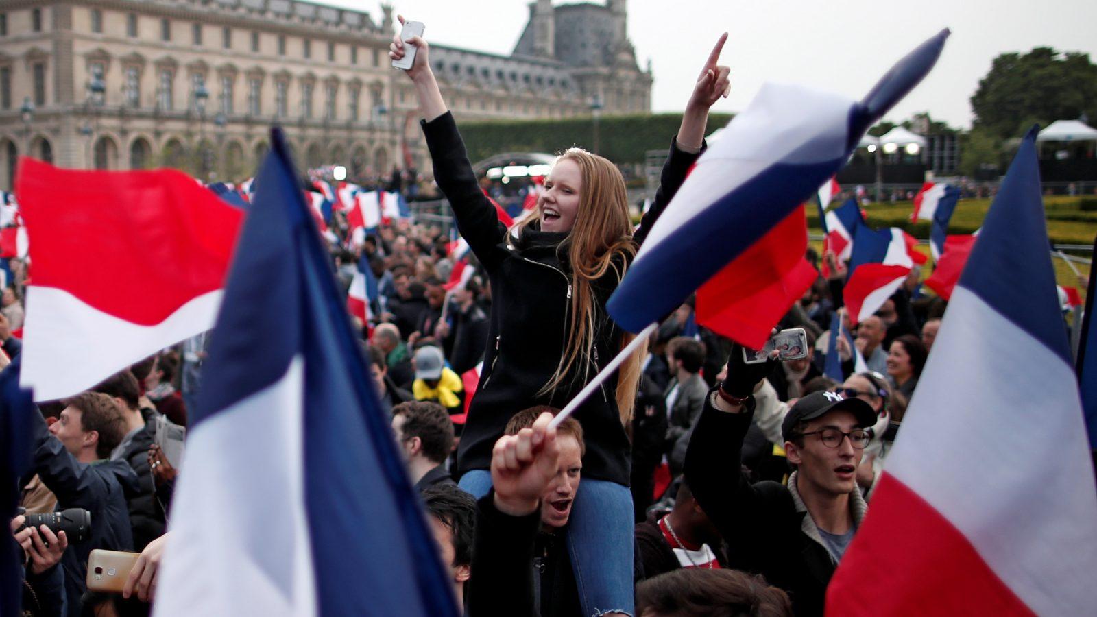 Supporters of Emmanuel Macron celebrate near the Louvre.