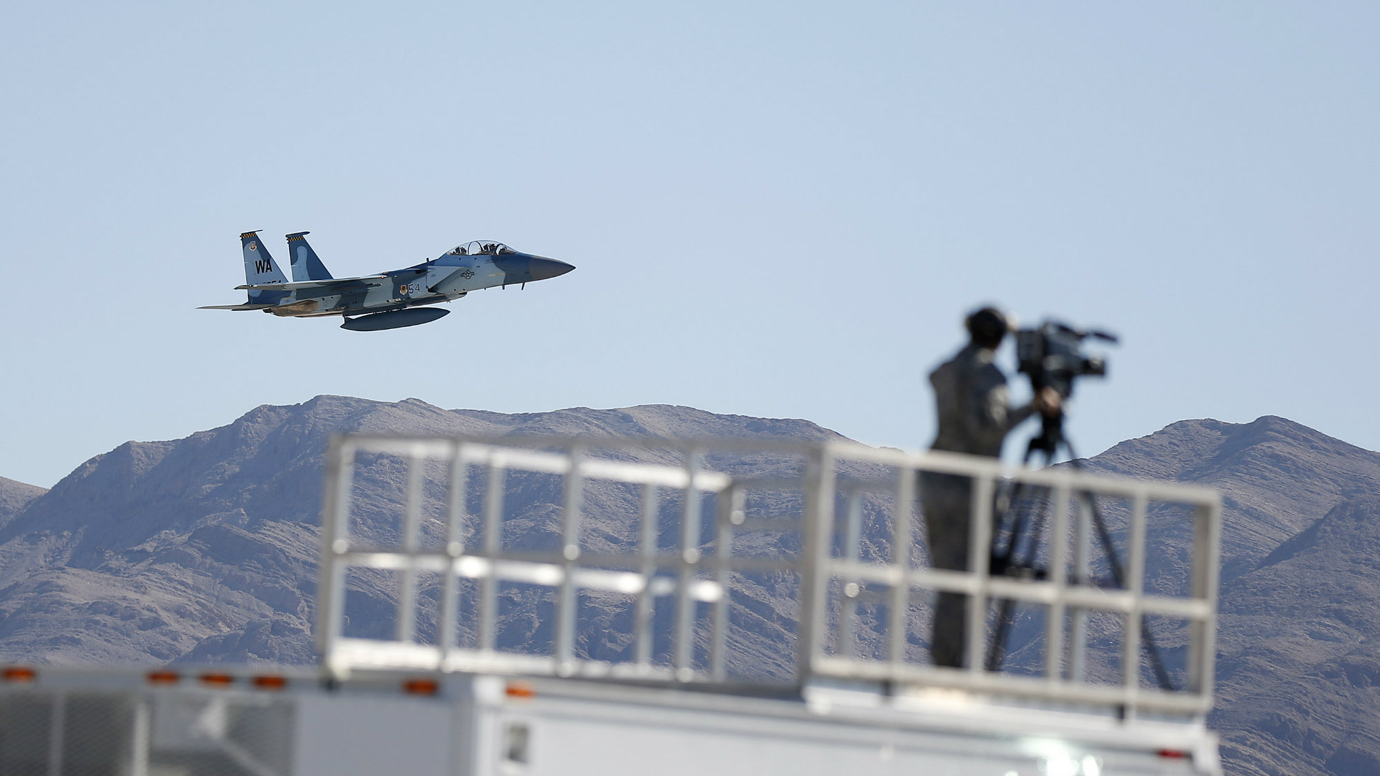 Capt. David Vincent and retired Air Force Brig. Gen. Charles Yeager perform a fly-by during their F-15D re-enactment flight commemorating Yeager's breaking of the sound barrier 65 years ago on Sunday, Oct. 14, 2012, at Nellis Air Force Base, Nev.