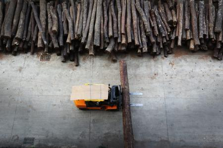 Mukula timber that is piled in a storage yard of a rosewood furniture factory.