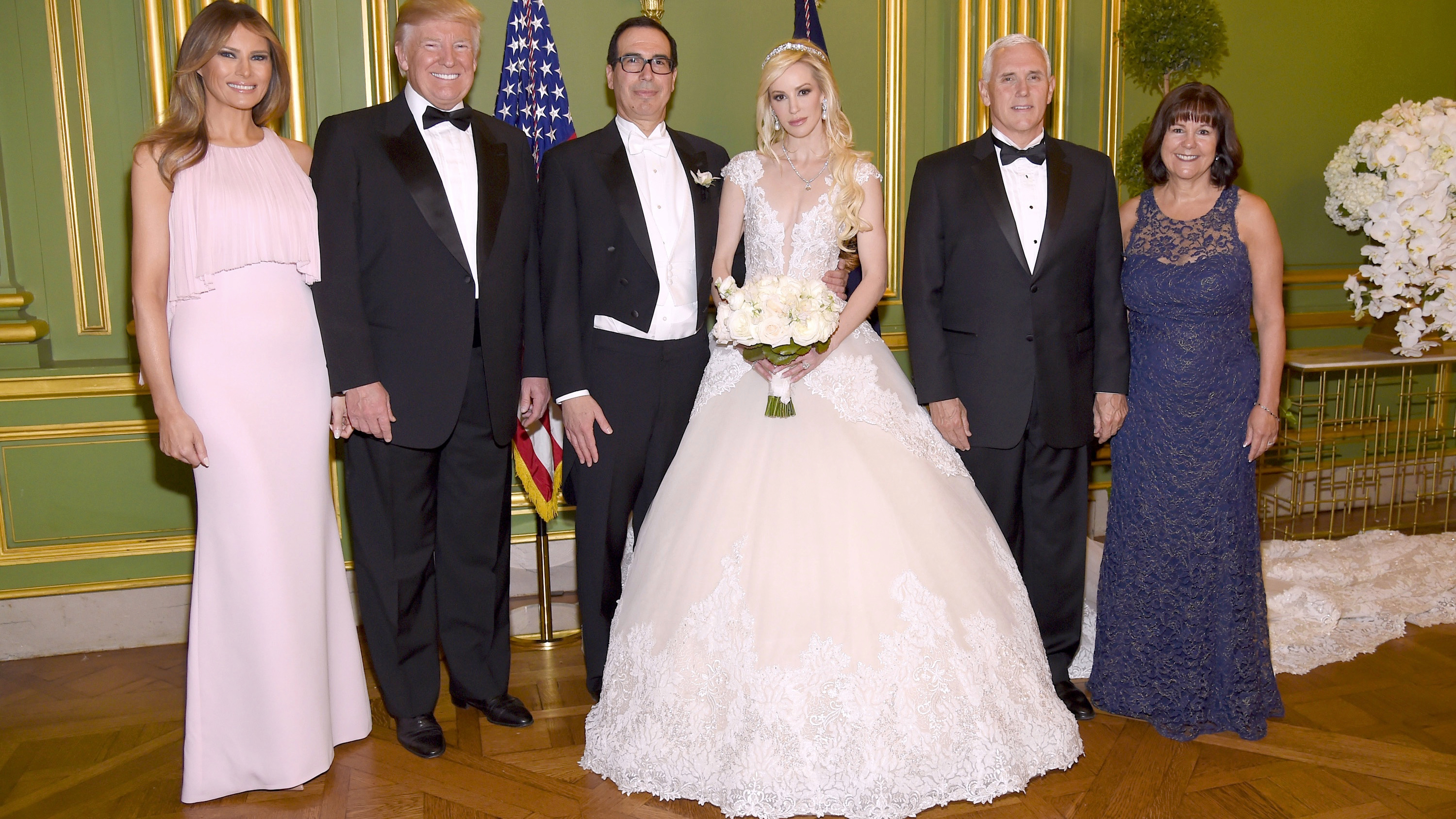 WASHINGTON, DC - JUNE 24: (Exclusive Coverage) (L-R) First Lady Melania Trump, President Donald Trump, Secretary of the Treasury Steven Mnuchin, Louise Linton, Vice President Mike Pence, and Second Lady Karen Pence pose at the wedding of Secretary of the Treasury Steven Mnuchin and Louise Linton on June 24, 2017 at Andrew Mellon Auditorium in Washington, DC. Louise Linton is wearing a custom Ines Di Santo gown with wedding ring and earrings by Martin Katz.  (Photo by Kevin Mazur/Getty Images for LS)