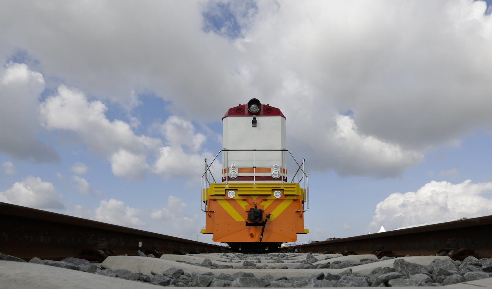 A new Kenya Railways locomotive which will be used to transport cargo freight using the new Mombasa to Nairobi Standard Gauge Railway (SGR) that had been constructed by the China Road and Bridge Corporation (CRBC) and was financed by Chinese government, is parked during an official flag off ceremony of the new cargo train by President Uhuru Kenyatta (not pictured) at port reitz in Mombasa, Kenya, 30 May 2017. The newly constructed SGR is expected to enhance business between the two cities by providing fast and affordable means of transportation.