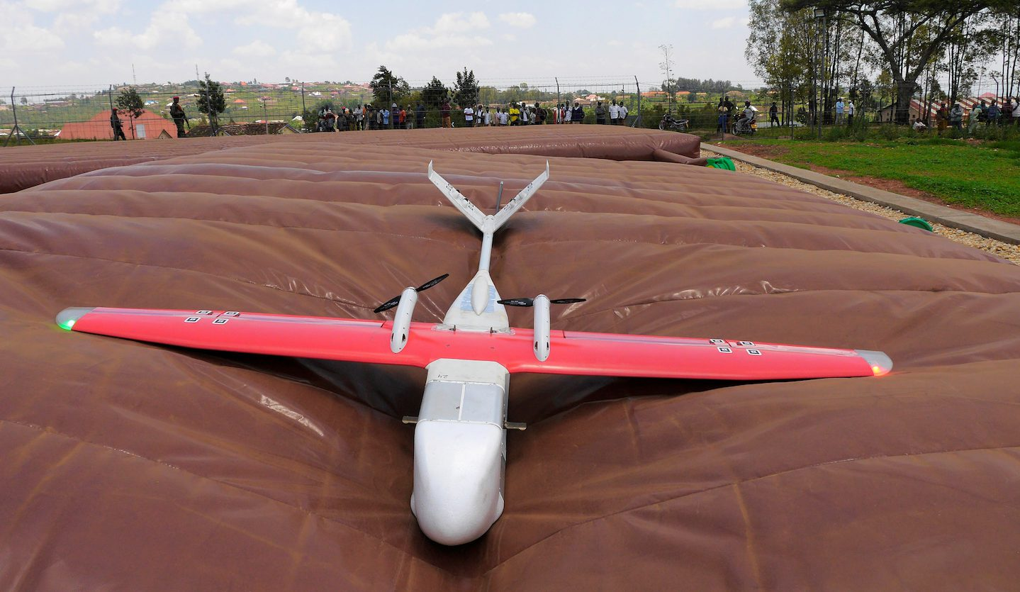 A drone is seen after landing on inflatable pad at the operation base in Muhanga, south of Rwanda's capital Kigali where Zipline, a California-based robotics company delivered their first blood to patients using a drone October 12, 2016. Picture taken October 12, 2016. REUTERS/James Akena - RTX2PJWF