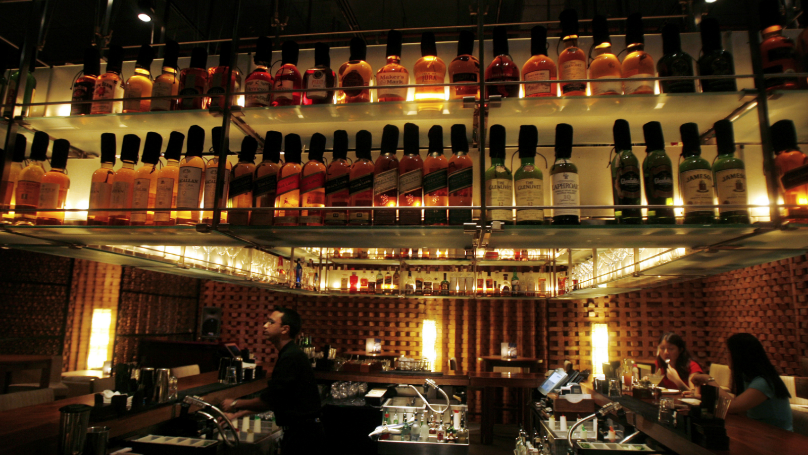 A bartender prepares a drink for customers at a bar in a luxury hotel in Mumbai November 22, 2008.