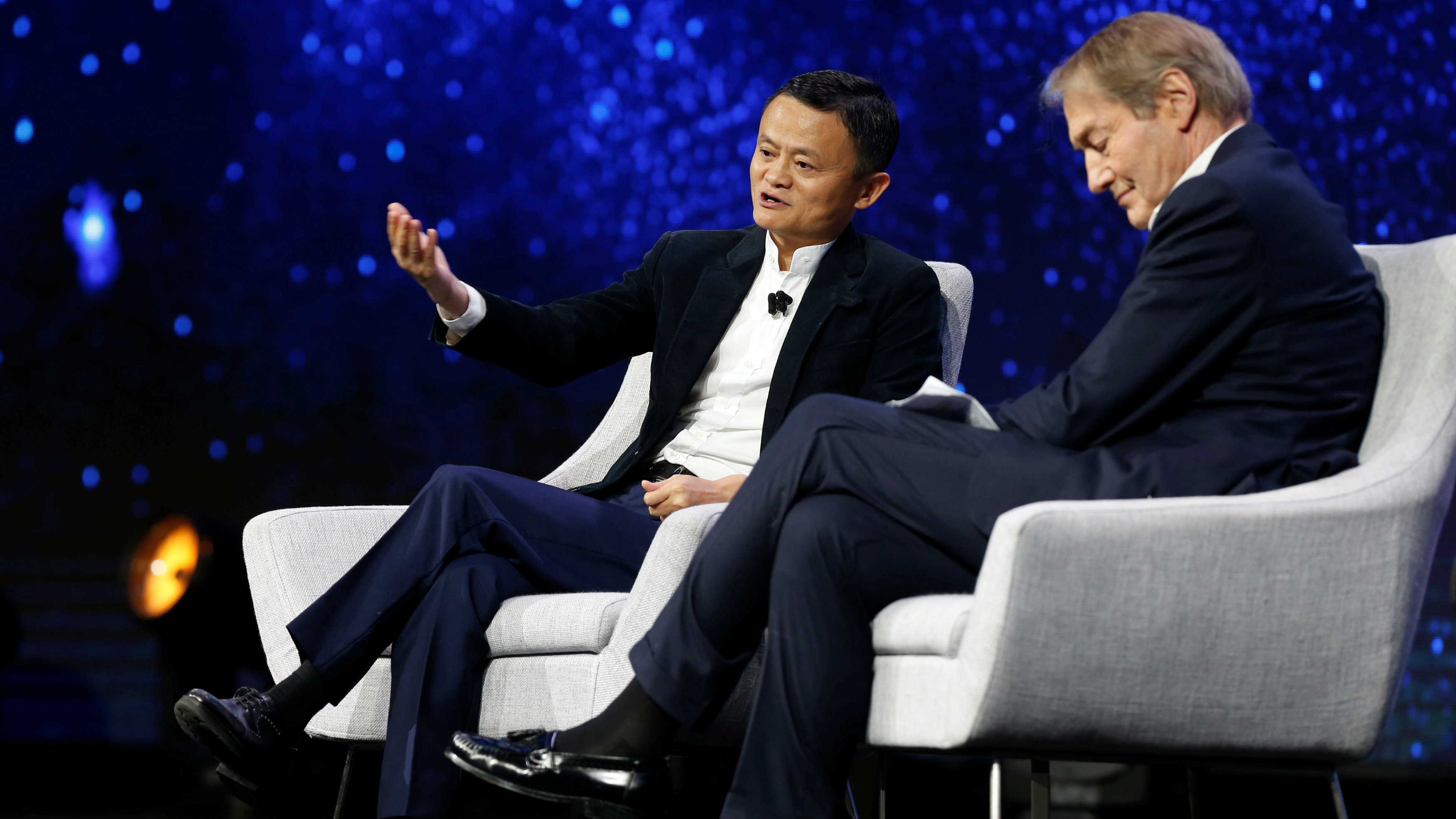 Jack Ma, Founder and Executive Chairman, Alibaba Groups, talks with American television host Charlie Rose (R ) during the inaugural Gateway 17 event at Cobo Center in Detroit, Michigan, U.S., June 20, 2017.
