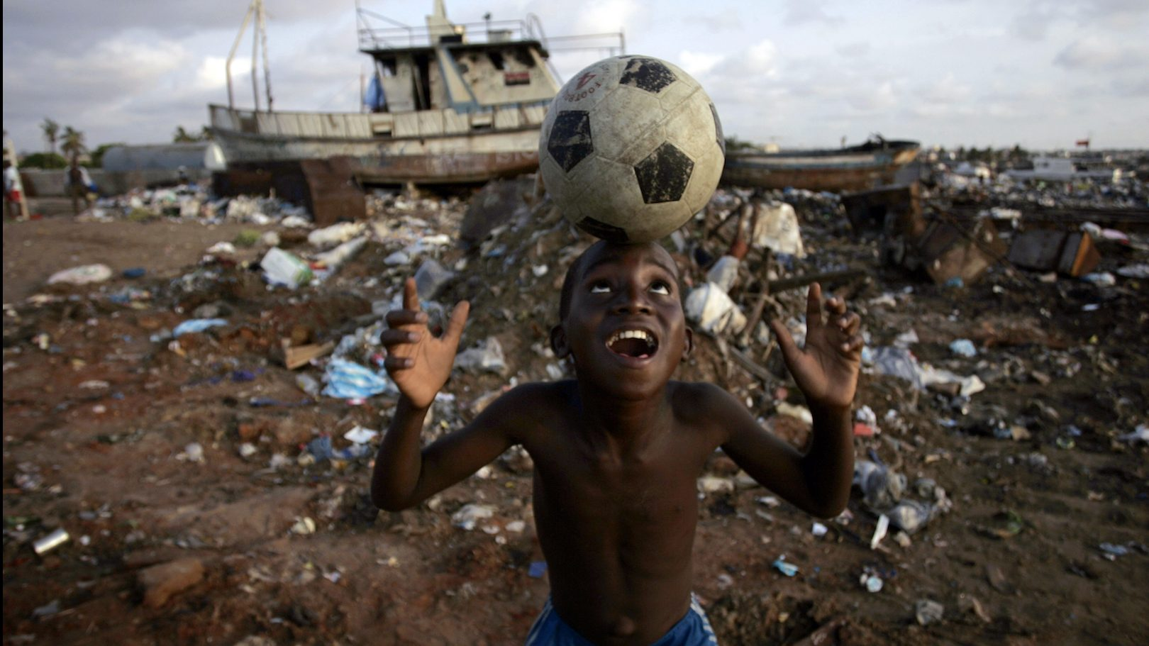 An Angolan youth plays soccer in the streets of the capital Luanda January 30, 2010.