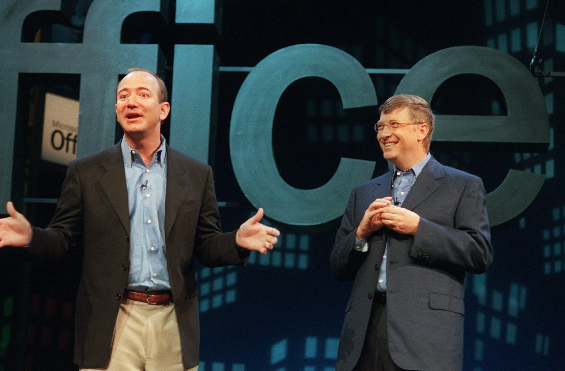 Jeff Bezos, founder and CEO of Amazon.com, left, meets with Bill Gates, Microsoft Corp. chairman and chief software architect, at a New York news conference to launch Microsoft's new software, Office XP, Thursday, May 31, 2001. Gates said Office XP will improve worker productivity, but he acknowledged that there was room for improvement to the product.
