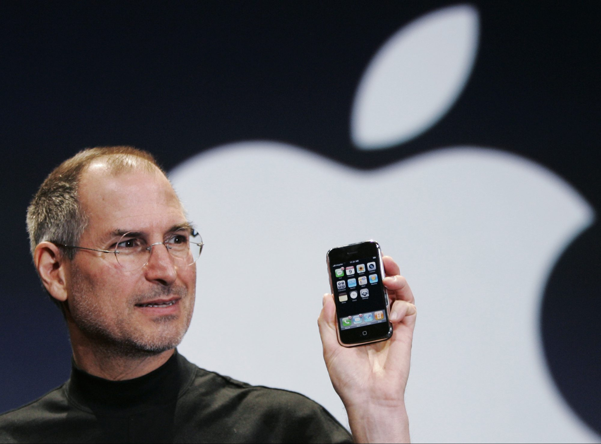 Apple CEO Steve Jobs holds up an Apple iPhone at the MacWorld Conference in San Francisco, in this Jan. 9, 2007 file photo. The hype around Apple Inc.'s upcoming iPhone is abundantly clear. But how the iPhone will leave its historical mark after June 29 is yet to be seen.