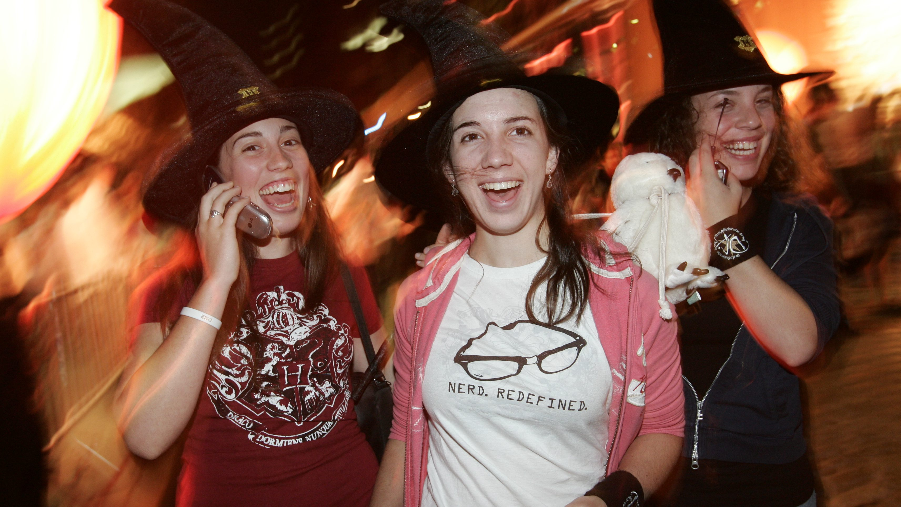 Costumed fans pose at the Harry Potter and the Deathly Hallows book release party at the Scholastic Book publishers headquarters in New York, July 21, 2007. (AP Images/Clark Jones/Courtesy of Scholastic, Inc.) ***FOR EDITORIAL USE ONLY***
