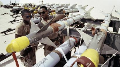 U.S. Air Force technicians prepare Arm-9, Arm-7, air to air missiles in Saudi Arabia for use on F-15 Eagle Fighter Planes. 1990 photo.