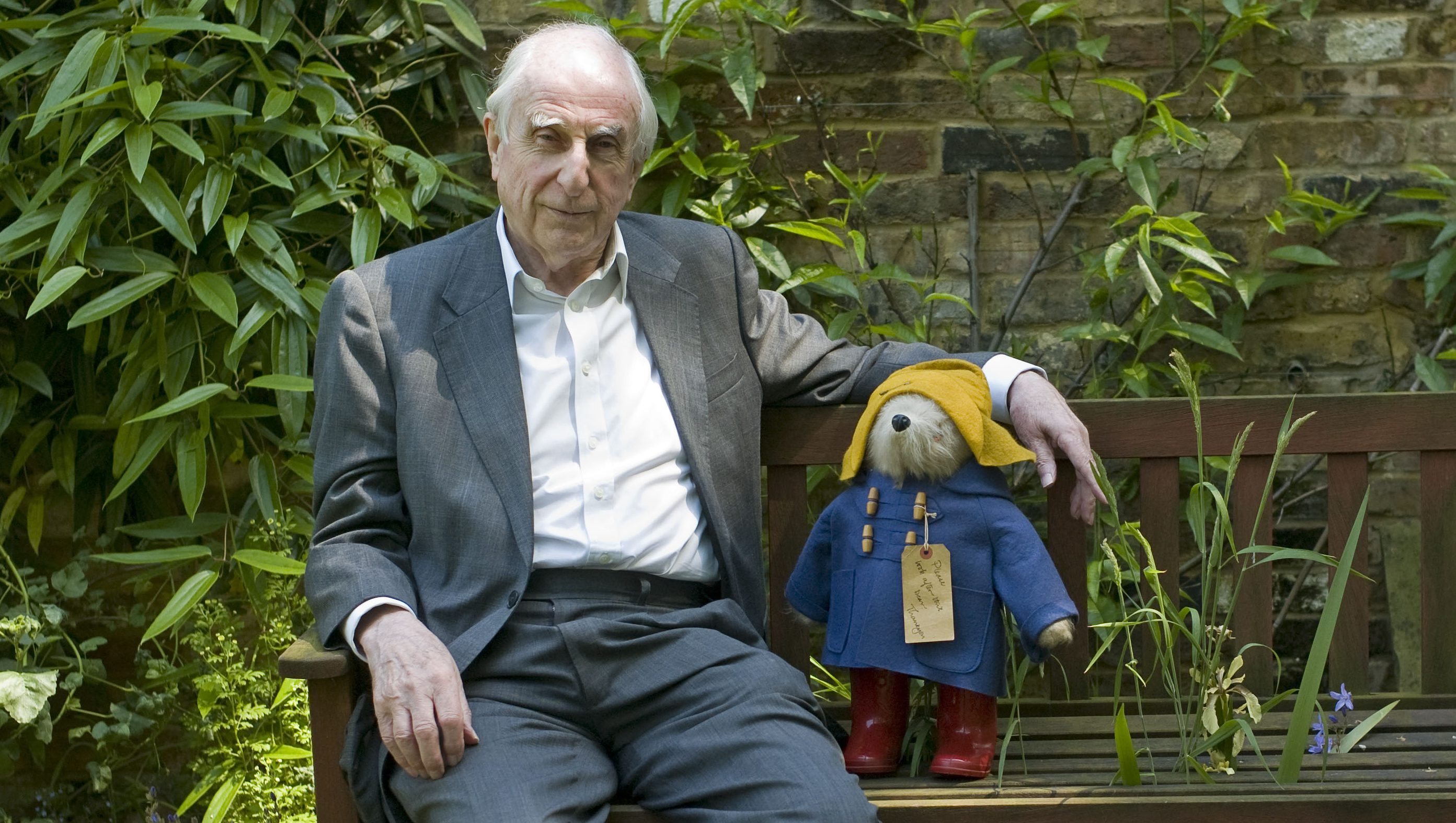 """British author Michael Bond sits with a Paddington Bear toy during an interview with The Associated Press in London, Thursday, June 5, 2008. Paddington Bear's first adventure appeared in print 50 years ago, and author Michael Bond is celebrating the milestone with a new adventure for the beloved bear, """"Paddington, Here and Now."""" (AP Photo/Sang Tan)"""
