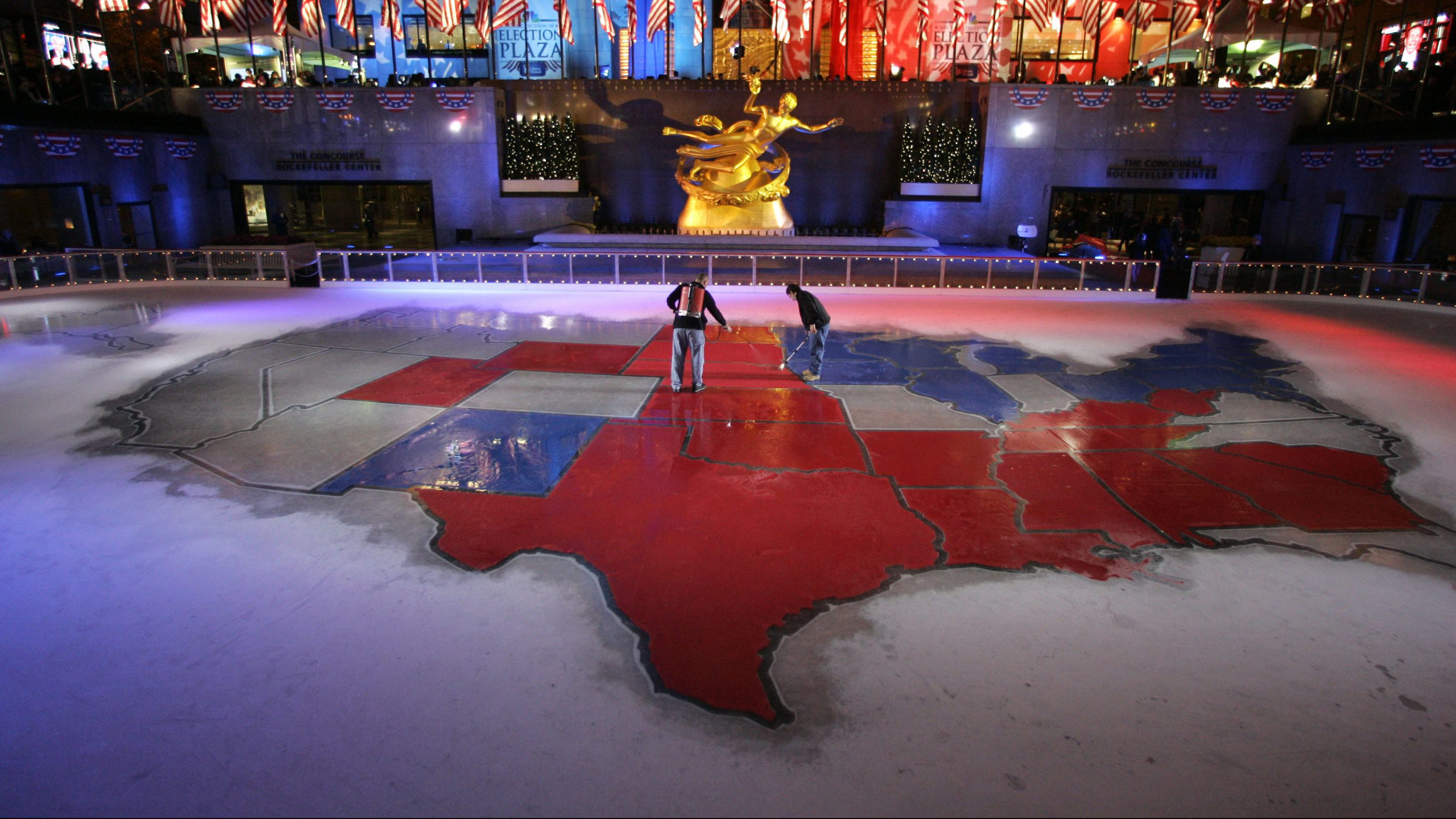 """NBC employees change Nebraska to red in the electoral map of the United State at the NBC News """"Election Plaza""""  in Rockefeller Center Tuesday, Nov. 4, 2008 in New York."""