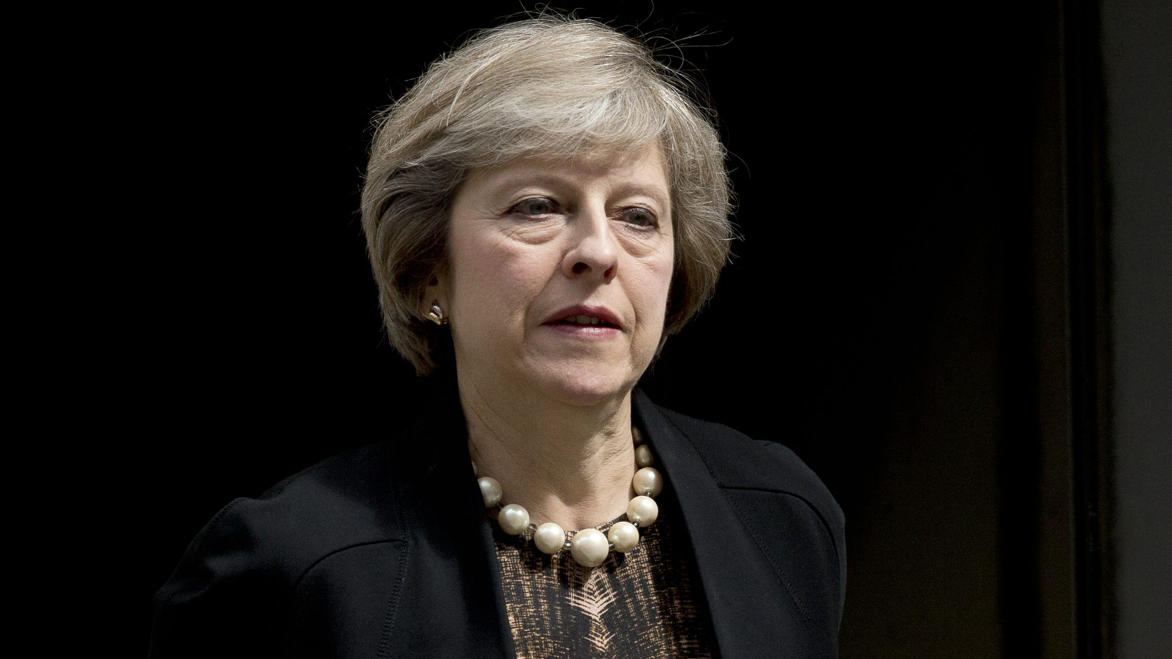 British Home Secretary and leadership candidate for Britain's ruling Conservative Party Theresa May leaves after attending a cabinet meeting at 10 Downing Street, in London, Tuesday, July 5, 2016. British Prime Minister David Cameron resigned on June 24 after Britain voted to leave the European Union in a referendum. (AP Photo/Matt Dunham)