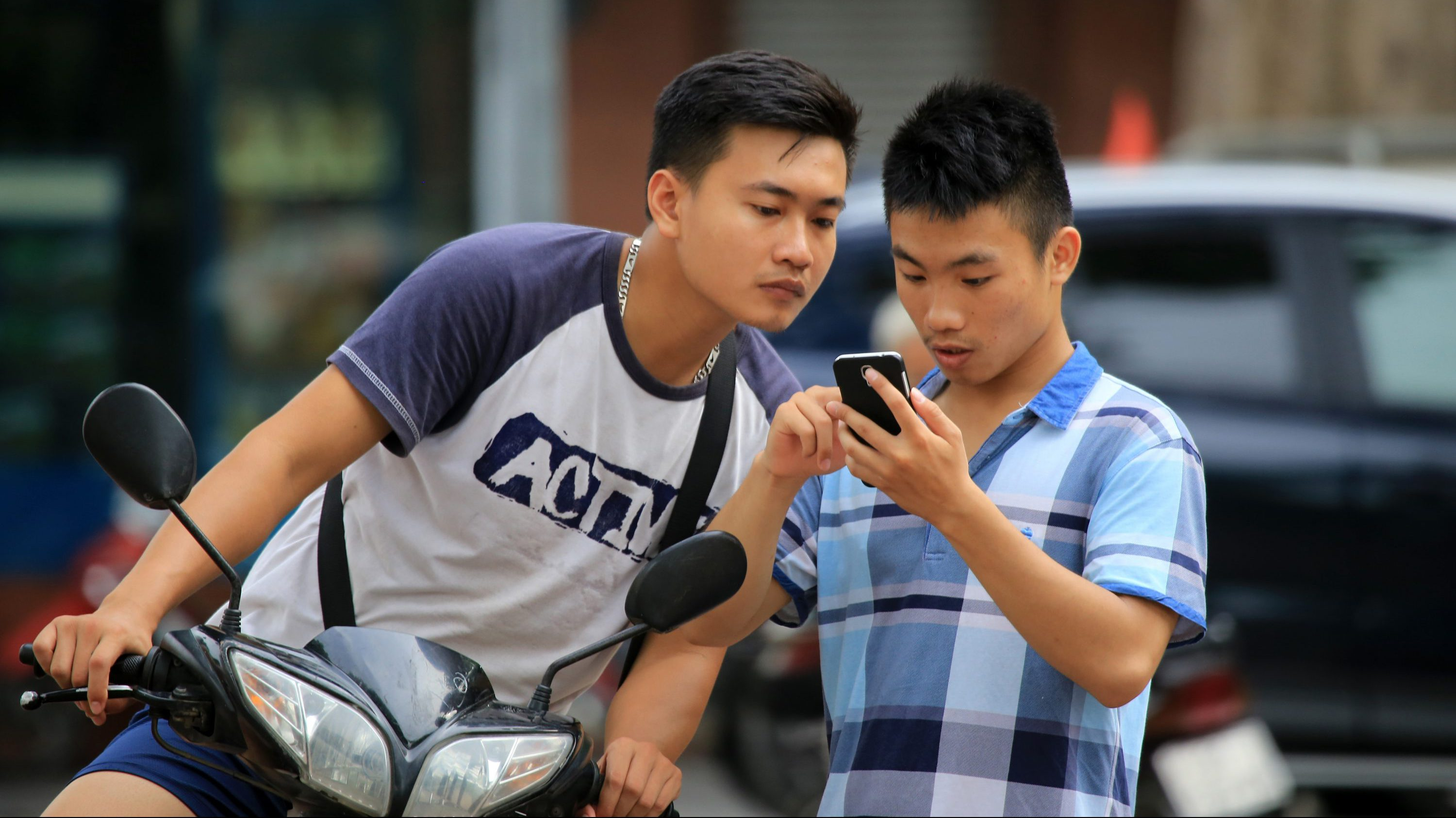 "A man plays ""Pokemon Go"" at a popular PokeStop in Hanoi, Vietnam on Saturday 13 August 2016. One week after being released in Vietnam, the game has become one of the most talked-about topics in the Southeast Asian country."