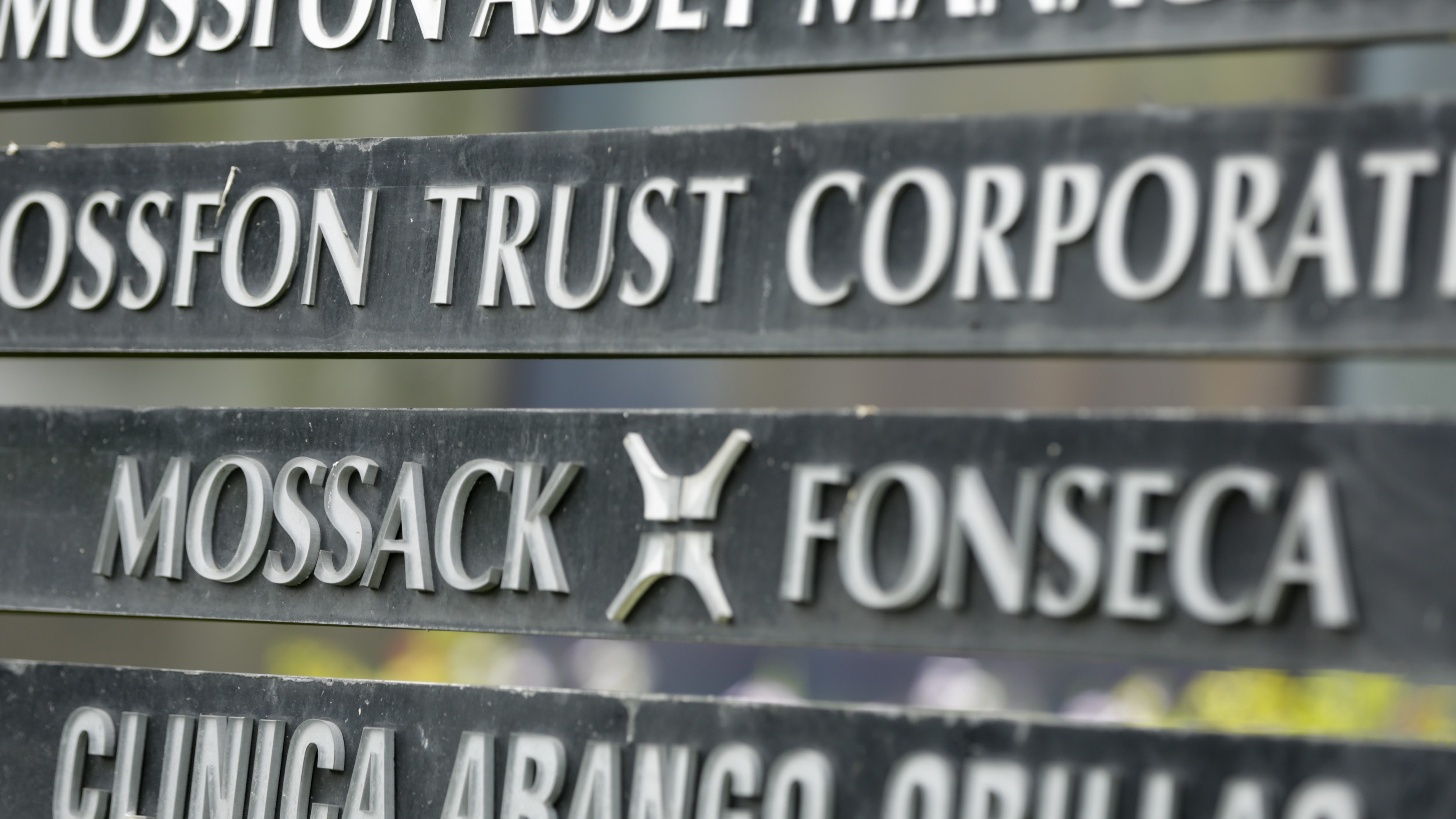 """FILE - In this Monday, April 4, 2016 file photo, a marquee of the Arango Orillac Building lists the Mossack Fonseca law firm, in Panama City. Denmark will buy leaked data from a Panamanian law firm that helped customers open offshore companies to avoid paying taxes, the Scandinavian country's taxation minister said Wednesday, Sept 7, 2016. Karsten Lauritzen said Denmark's tax authorities had received an anonymous offer over the summer to acquire data from the so-called """"Panama Papers"""" that could involve up to 600 people. The ministry said communication with the anonymous source was made via encrypted channels. (AP Photo/Arnulfo Franco, File)"""