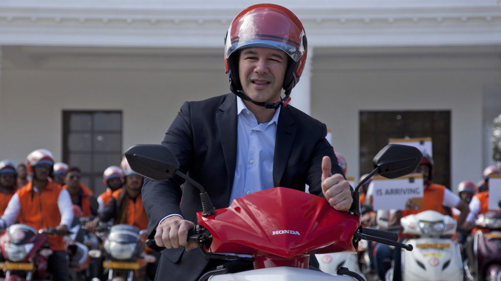 Uber CEO Travis Kalanick, poses during the launch of its bike-sharing product, uberMOTO, in Hyderabad, India, Tuesday, Dec. 13, 2016. (AP Photo/Mahesh Kumar A.)