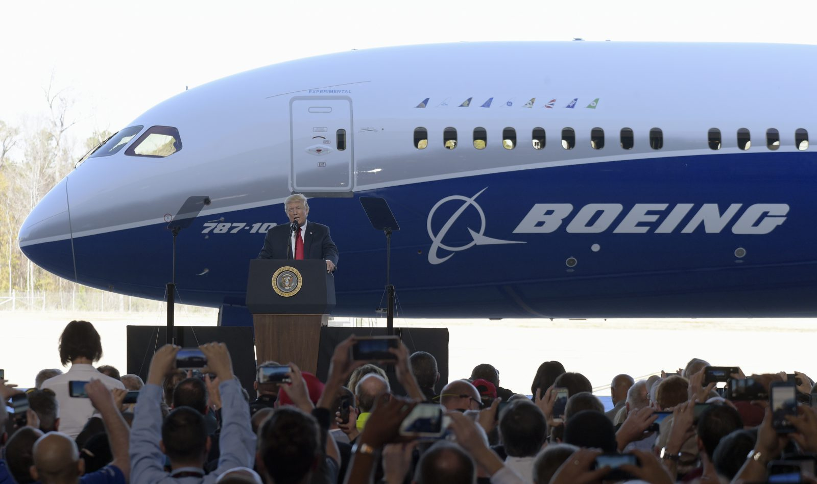 President Donald Trump speaks in front of the Boeing 787 Dreamliner while visiting the Boeing South Carolina facility in North Charleston, S.C., Friday, Feb. 17, 2017. Trump visited the plant before heading to his Mar-a-Lago estate in Palm Beach, Fla. for the weekend. (AP Photo/Susan Walsh)