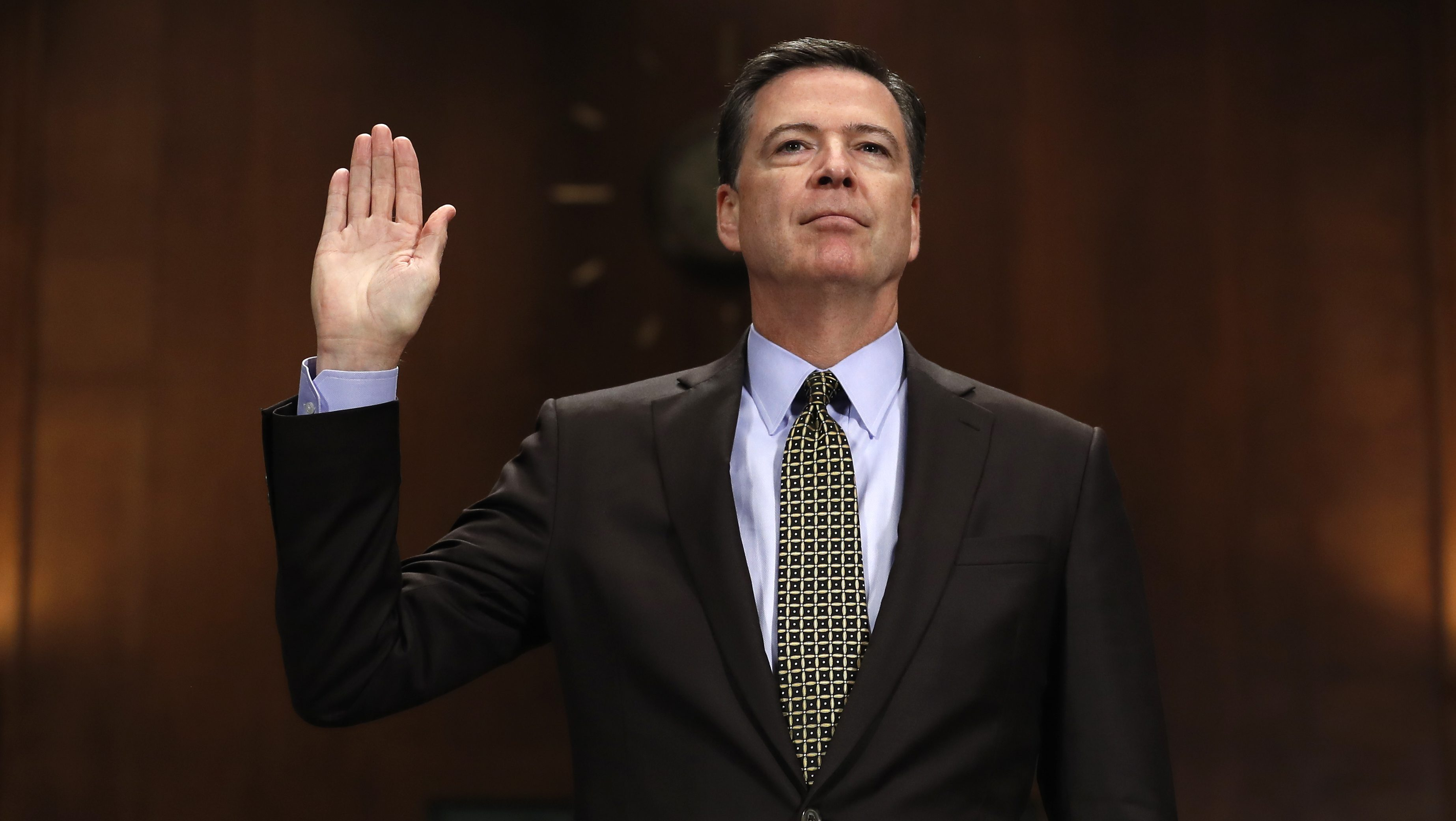 """FBI Director James Comey is sworn-in on Capitol Hill in Washington, Wednesday, May 3, 2017, prior to testifying before the Senate Judiciary Committee hearing: """"Oversight of the Federal Bureau of Investigation."""" (AP Photo/Carolyn Kaster)"""