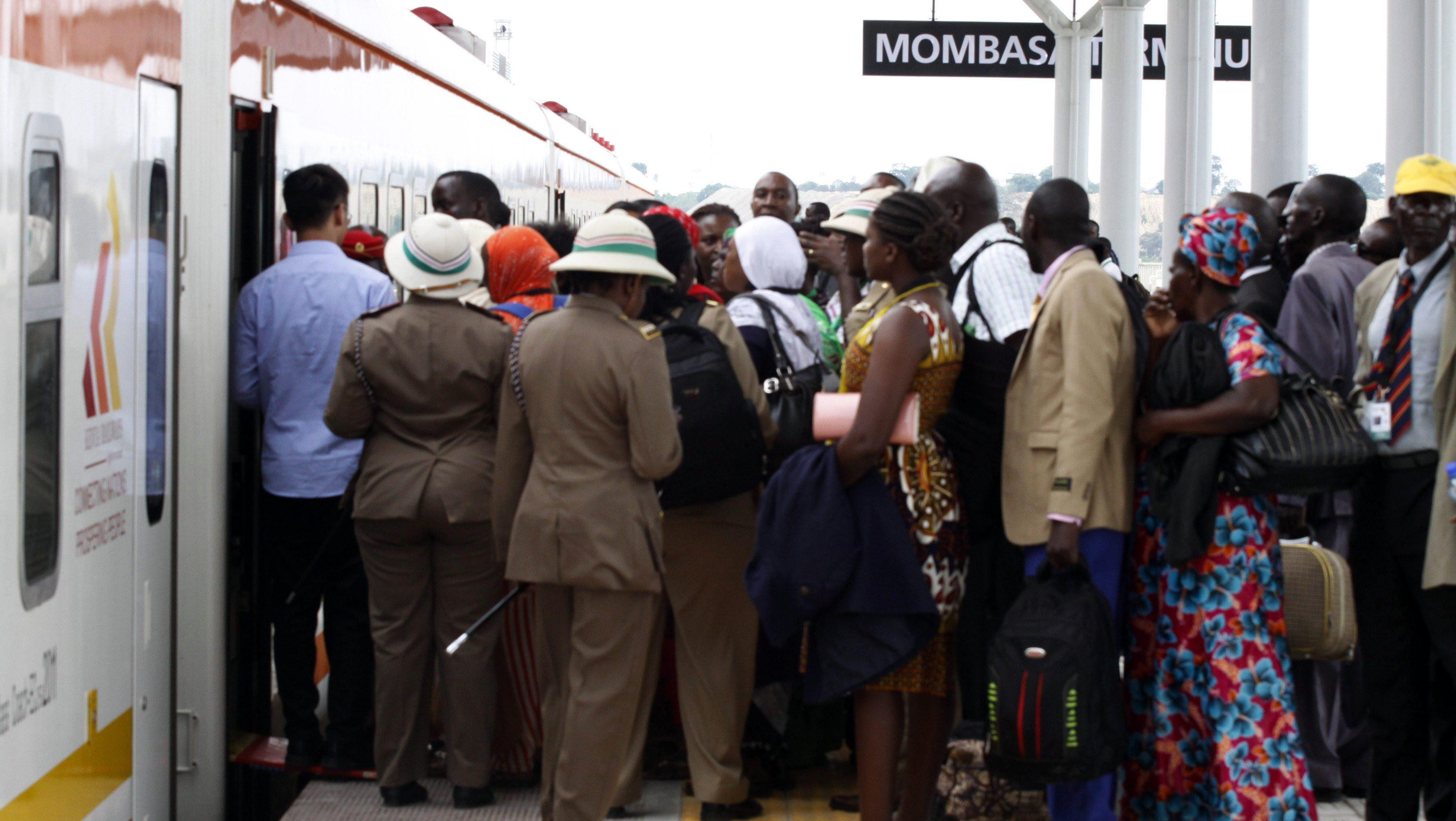 Kenyans wait to board a train at the Mombasa Terminus in Nairobi, Kenya Wednesday, May 31, 2017