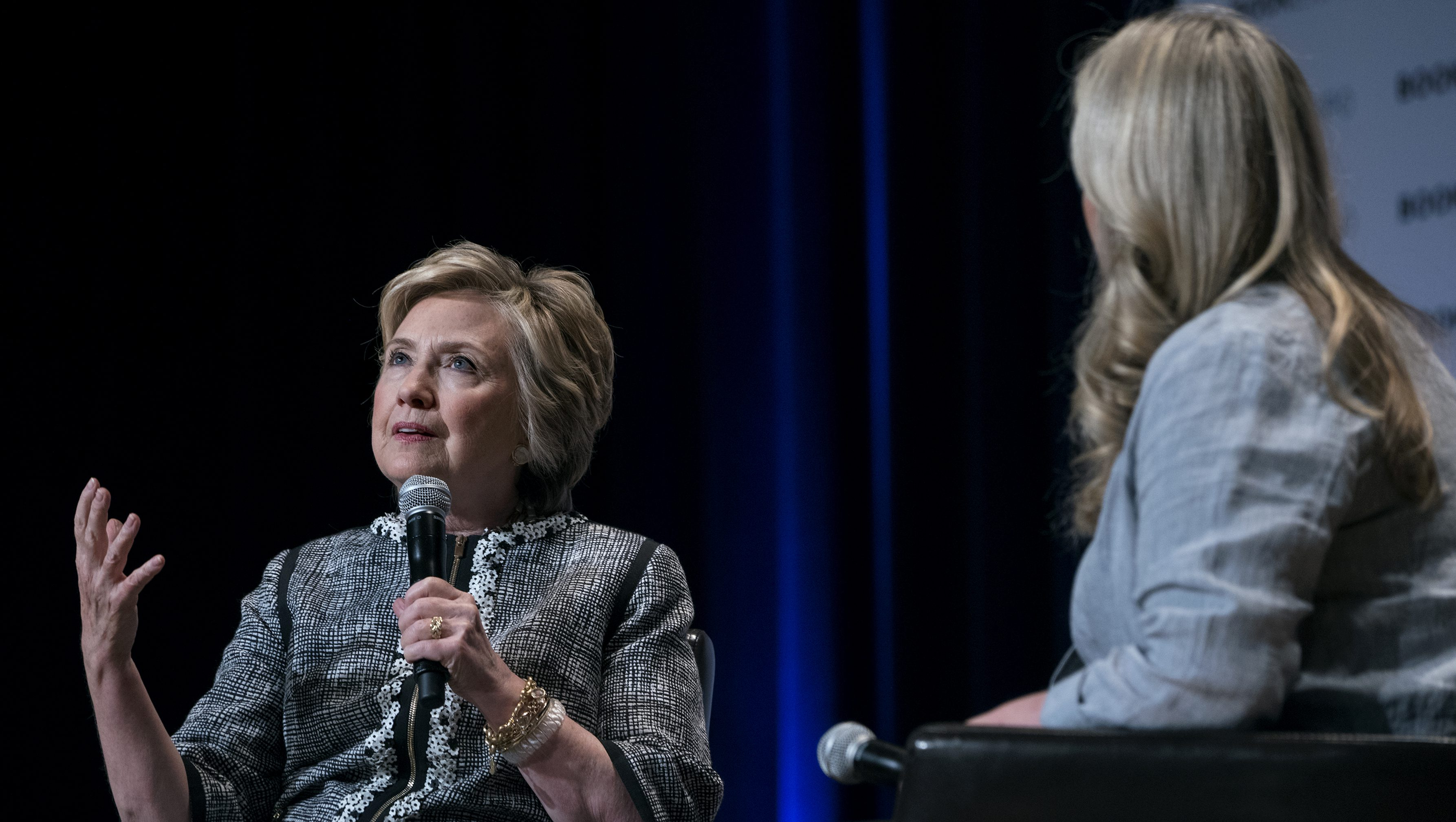 Former Secretary of State Hillary Clinton speaks alongside moderator and author Cheryl Strayed during the Book Expo event in New York Thursday, June 1, 2017. (AP Photo/Craig Ruttle)