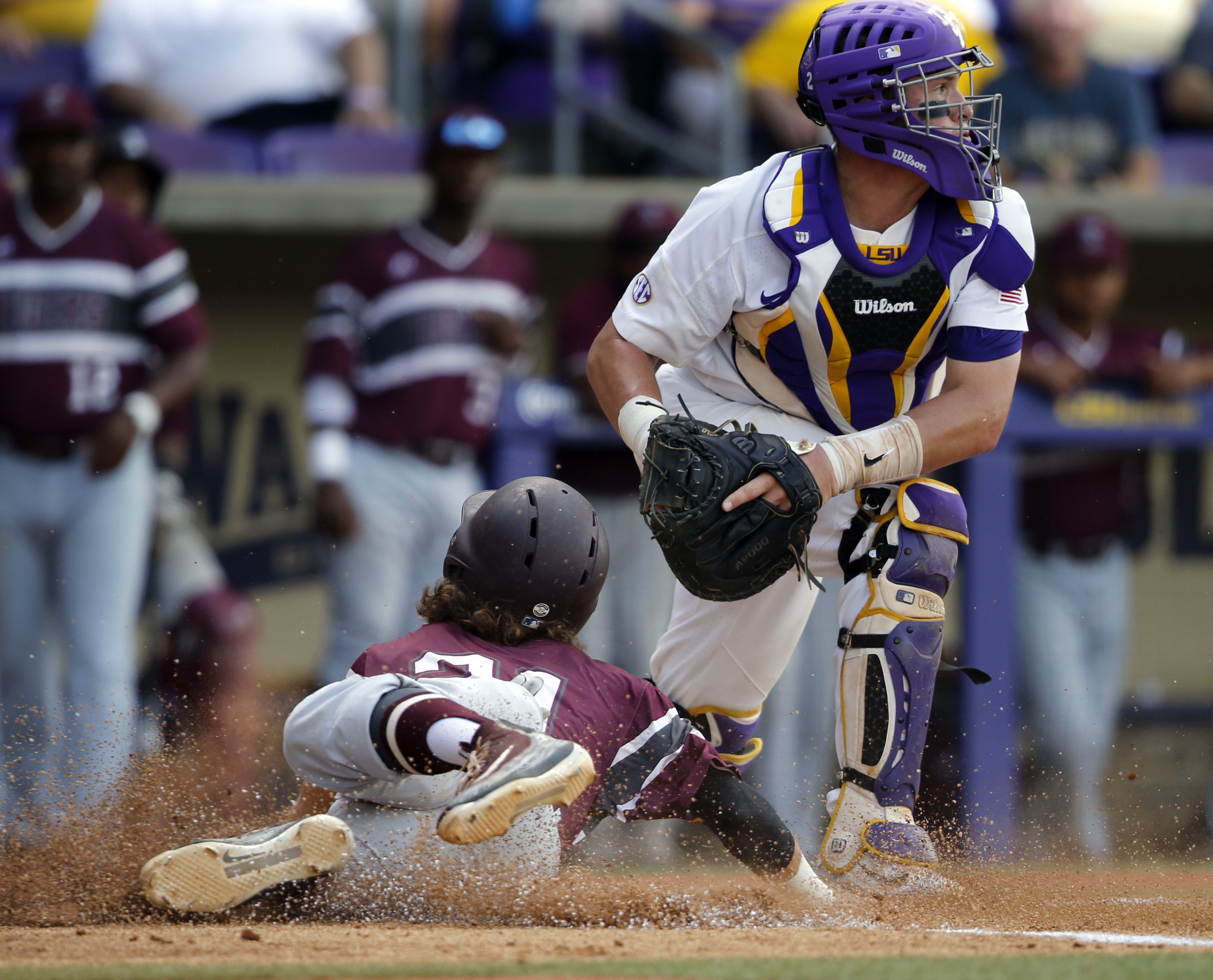 Texas Southern infielder Gaudencio Lucca (21) is tagged out at the plate by LSU catcher Michael Papierski in the first inning of a game at an NCAA college baseball regional tournament in Baton Rouge, La., Friday, June 2, 2017.
