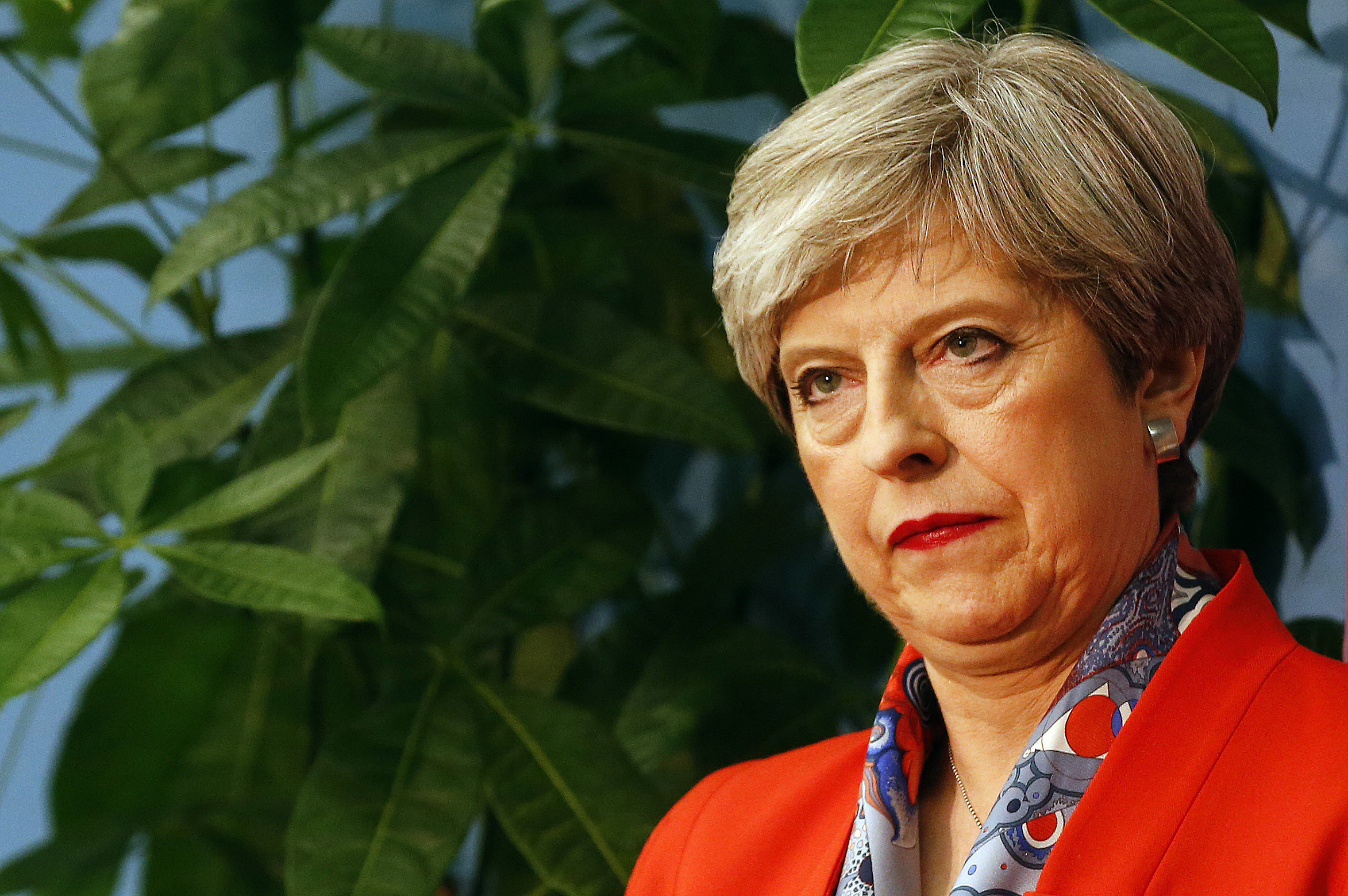 Britain's Prime Minister Theresa May listens as the declaration at her constituency is made for in the general election in Maidenhead, England, Friday, June 9, 2017. British Prime Minister Theresa May's gamble in calling an early election appeared Friday to have backfired spectacularly, after an exit poll suggested her Conservative Party could lose its majority in