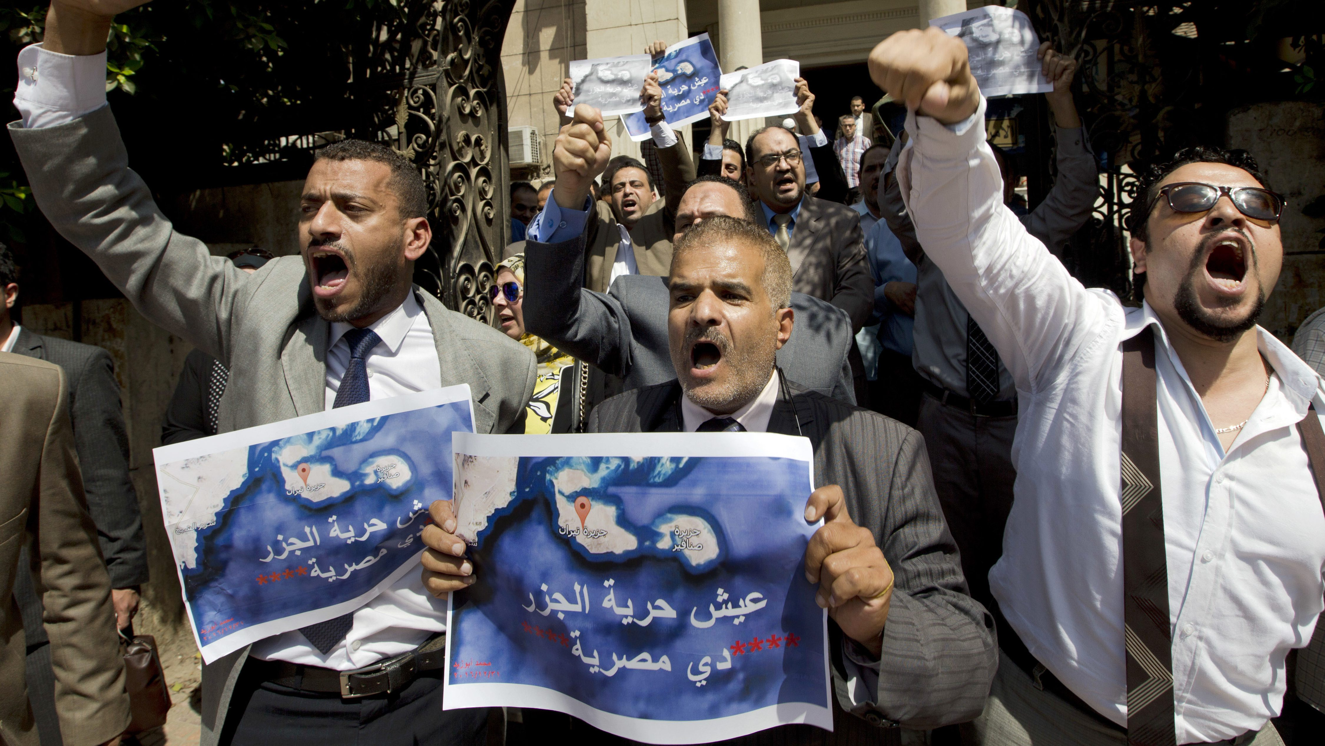 "FILE - In this Tuesday, June 13, 2017, file photo, dozens of lawyers shout slogans during a protest against the accord to hand over control of two strategic Red Sea islands, Tiran and Sanafir, to Saudi Arabia in front of the lawyers syndicate in Cairo. The tempestuous parliament approval of a deal transferring two Red Sea islands to Saudi Arabia is putting Egypt's government at odds with the judiciary and providing the country's battered opposition a nationalist cause to whip up at a time of growing economic distress. Arabic on the Red Sea map reads, "" bread.. freedom, the islands are Egyptians""."
