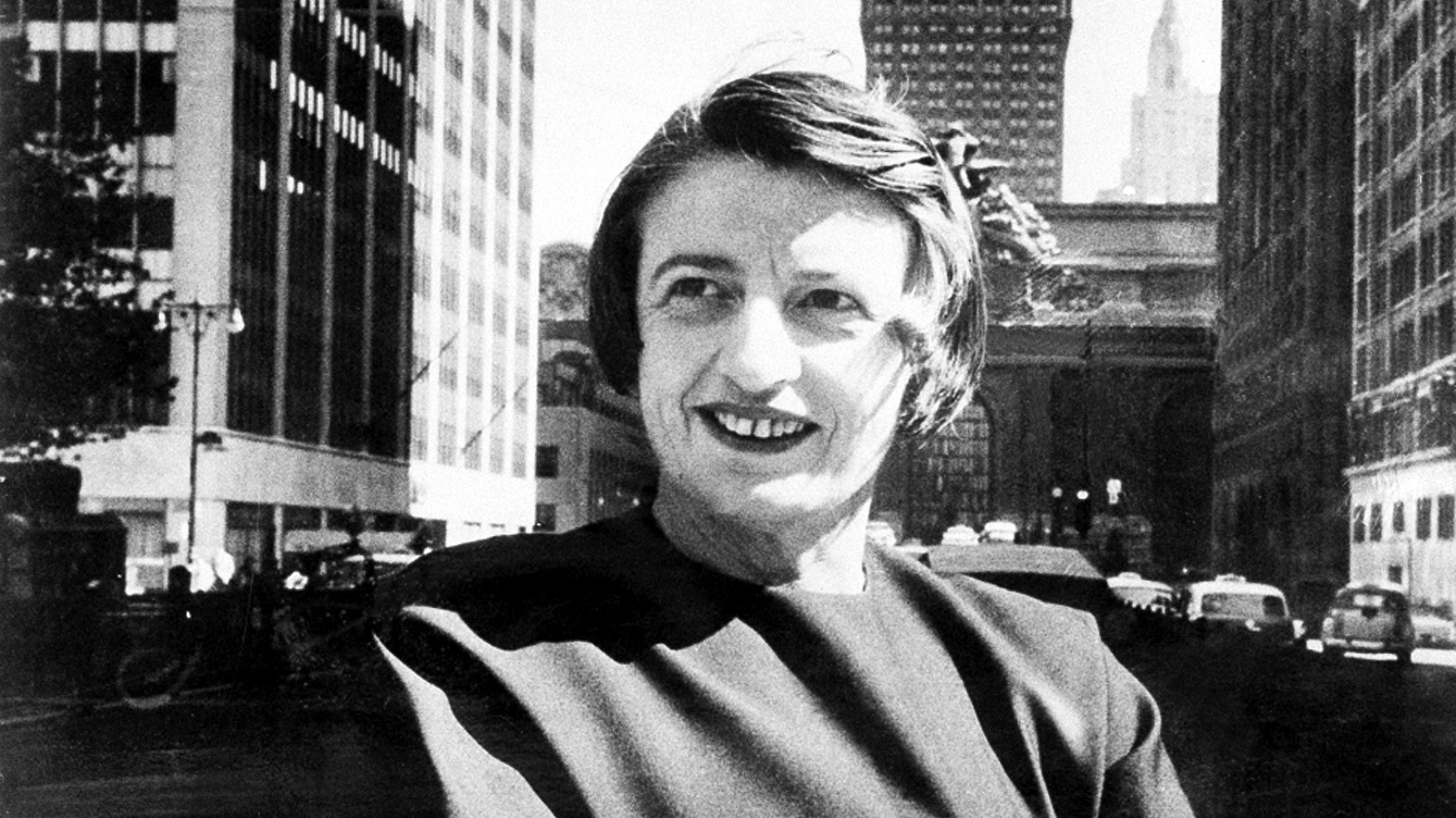 "FILE - This 1962 file photo Ayn Rand, Russian-born American novelist, is photographed in New York with Grand Central Terminal in the background.  A Rand novel written, temporary shelved and later published as a play is finally being released in its original form. The New American Library, an imprint of Penguin Random House, announced Thursday, Dec. 4, 2014,  that Rand's ""Ideal"" would be published July 7.  ()"