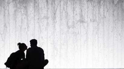 couple silhouetted against fountain