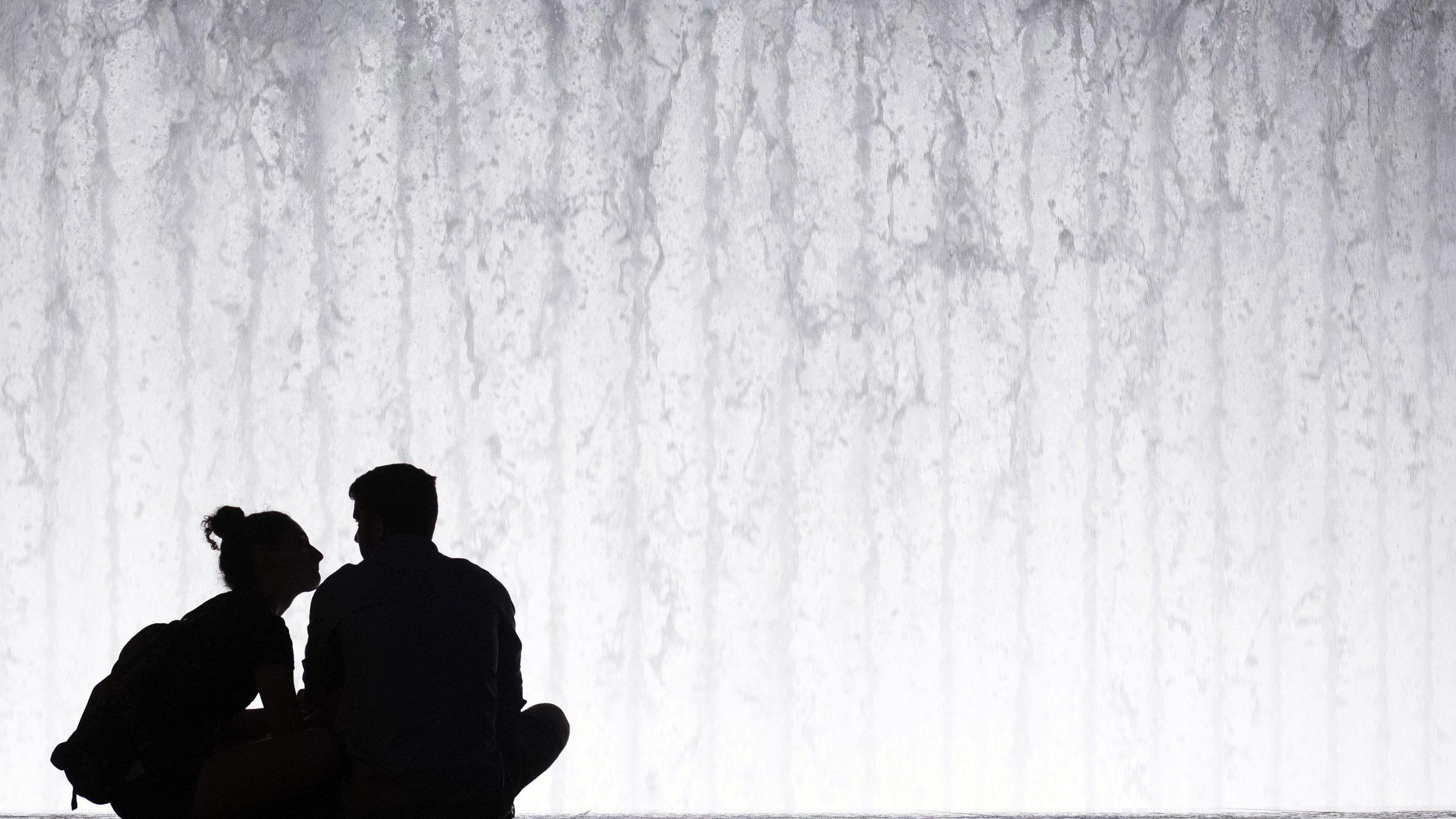 A Couple Is Silhouetted Against The Lincoln Center Fountain Friday Aug 1