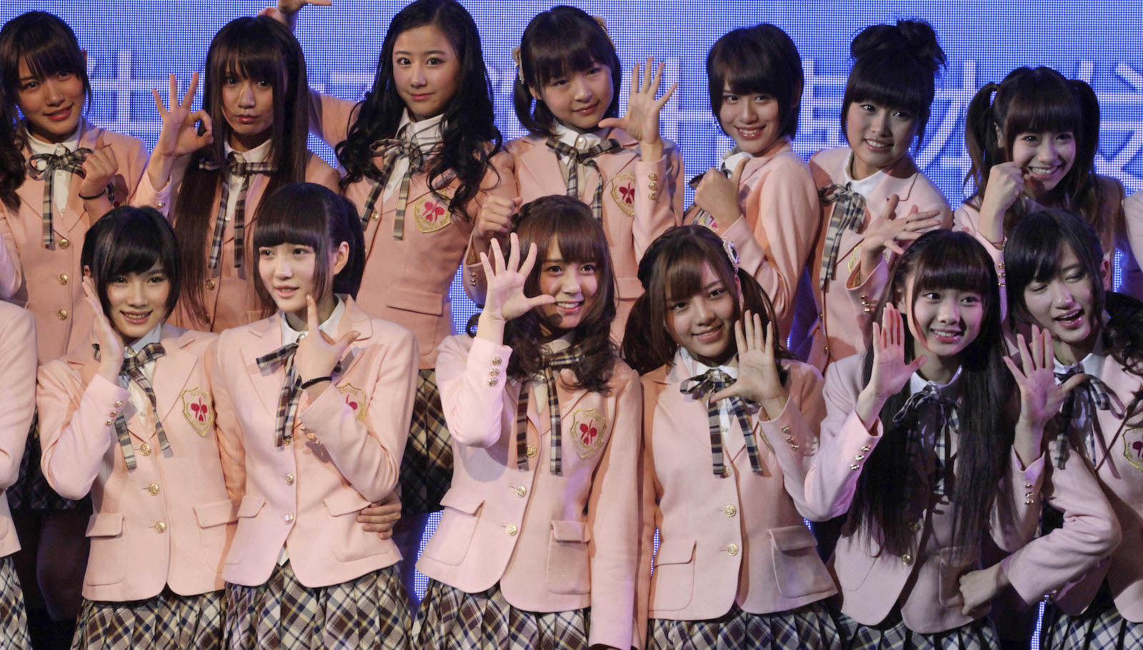 Members of SNH48, a Chinese idol group that AKB48 sister group outside of Japan, and it is based in Shanghai, pose for the photographers during the press conference before performing their first stage on Saturday Jan. 12, 2013 in Shanghai, China. (AP Photo/Eugene Hoshiko)