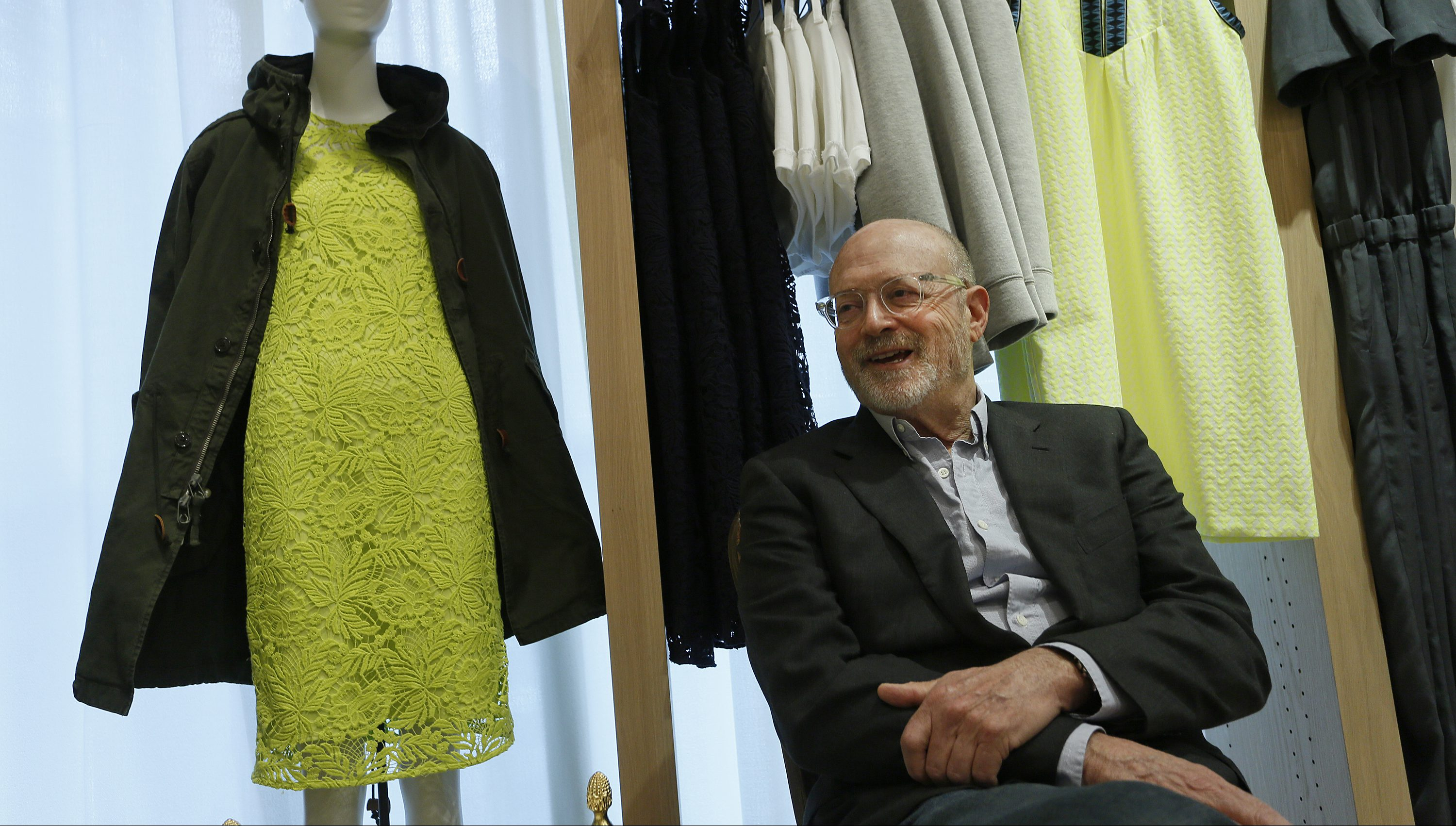 J. Crew CEO Mickey Drexler smiles during an interview at the new J. Crew store in Hong Kong, Wednesday, May 21, 2014. U.S. fashion retailer J. Crew is opening a pair of shops in Hong Kong. It's the latest Western brand carving out a foothold in the notoriously high-rent city as it explores future expansion in the lucrative China market. (AP Photo/Vincent Yu)
