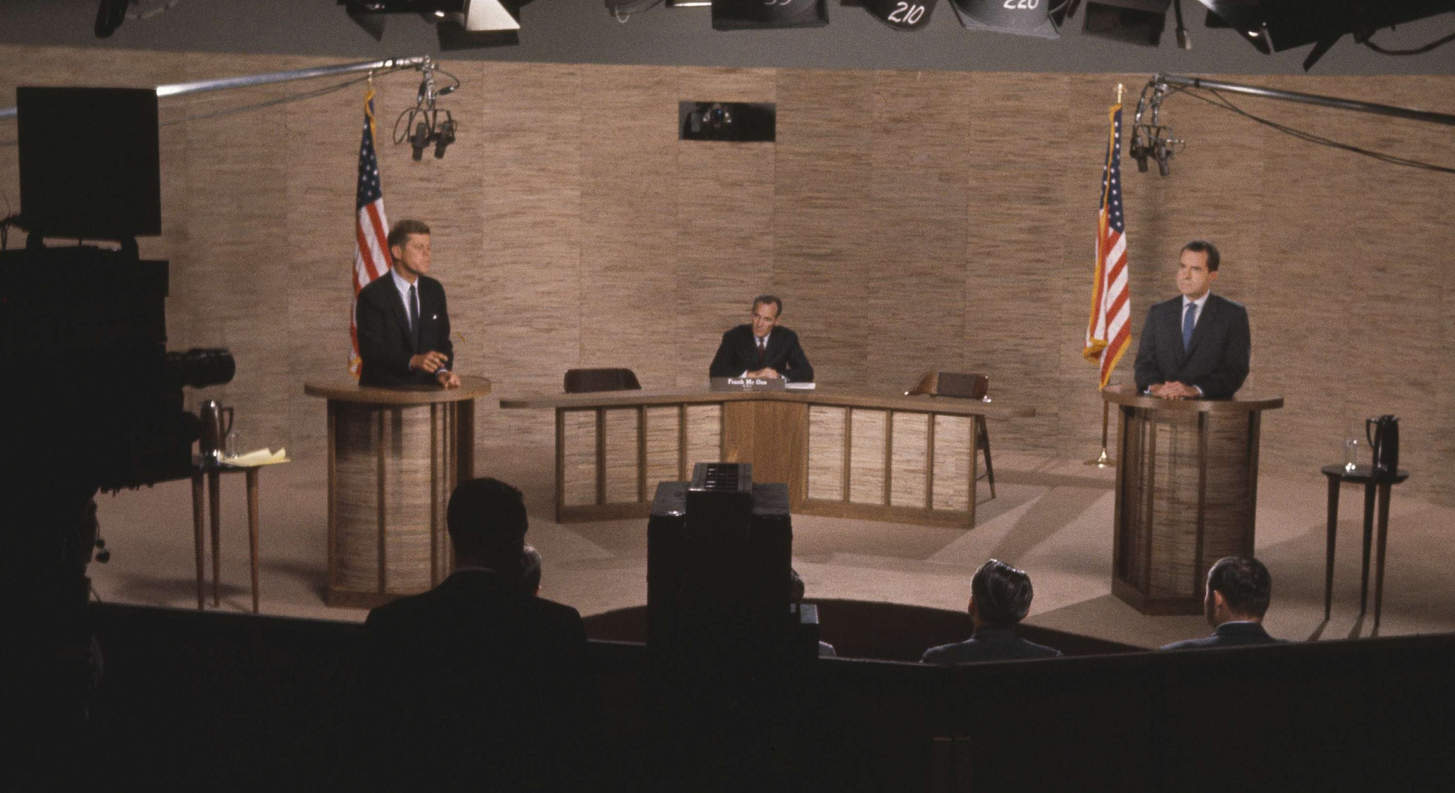 Newsman Howard K. Smith, center, acts as moderator during the debate between Sen. John F. Kennedy (D-Mass.), right, and Vice President Richard M. Nixon, in Washington, D.C., Oct. 7, 1960.