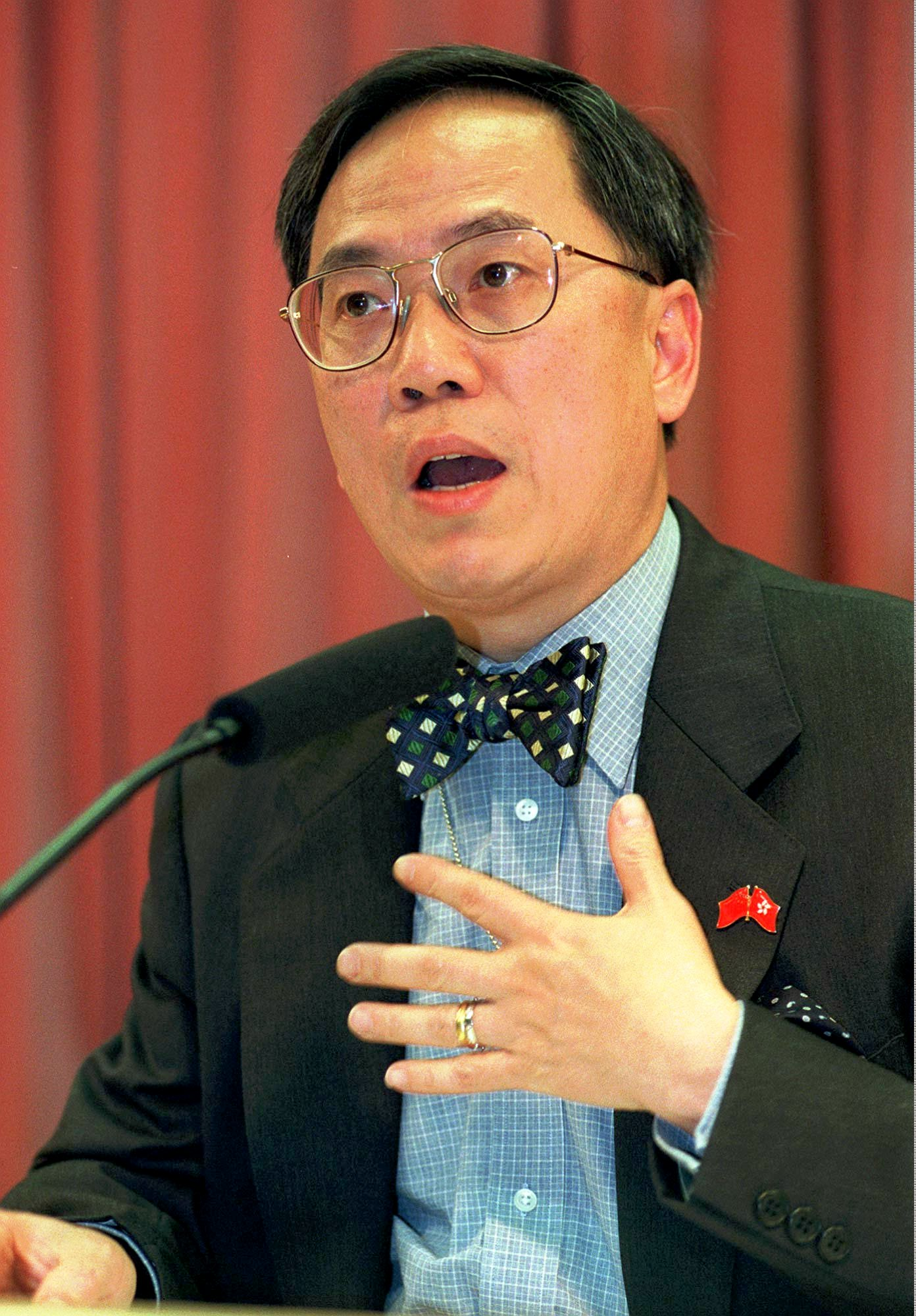 Hong Kong's Financial Secretary Donald Tsang gestures during a press conference Friday, May 29, 1998 in Hong Kong. Tsang said that Hong Kong's economy contracted for the first time in almost 13 years in the first quarter of Asia's financial crisis.