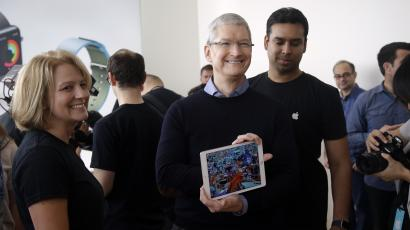 Apple CEO Tim Cook, shows off a new iPad during an event at Apple headquarters Monday, March 21, 2016, in Cupertino, Calif.