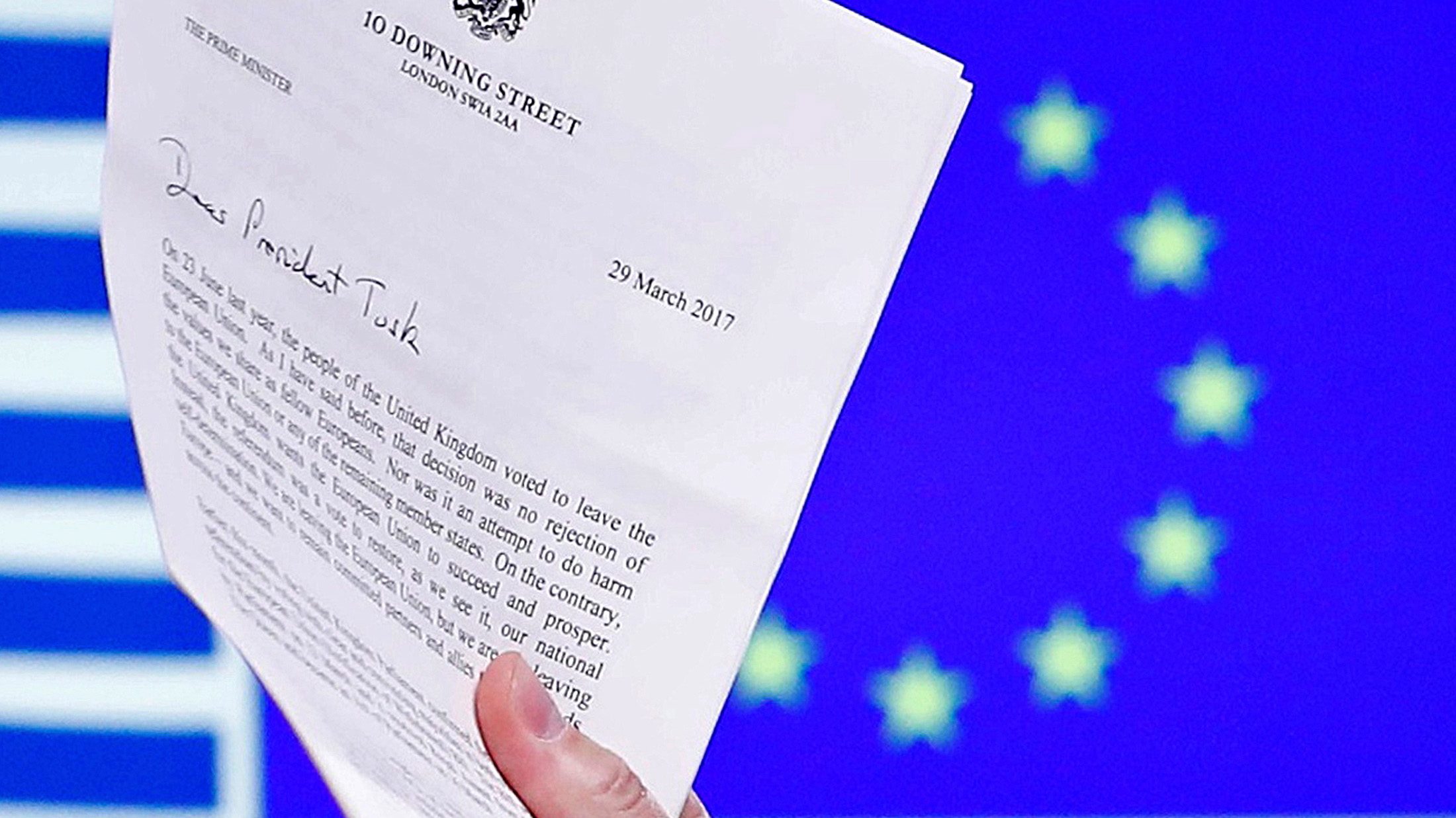 EU Council President Donald Tusk holds British Prime Minister Theresa May's Brexit letter, which was delivered by Britain's permanent representative to the European Union Tim Barrow (not pictured) that gives notice of the UK's intention to leave the bloc under Article 50 of the EU's Lisbon Treaty, in Brussels, Belgium, March 29, 2017. Picture taken March 29, 2017.  REUTERS/Yves Herman - RTX33BEP