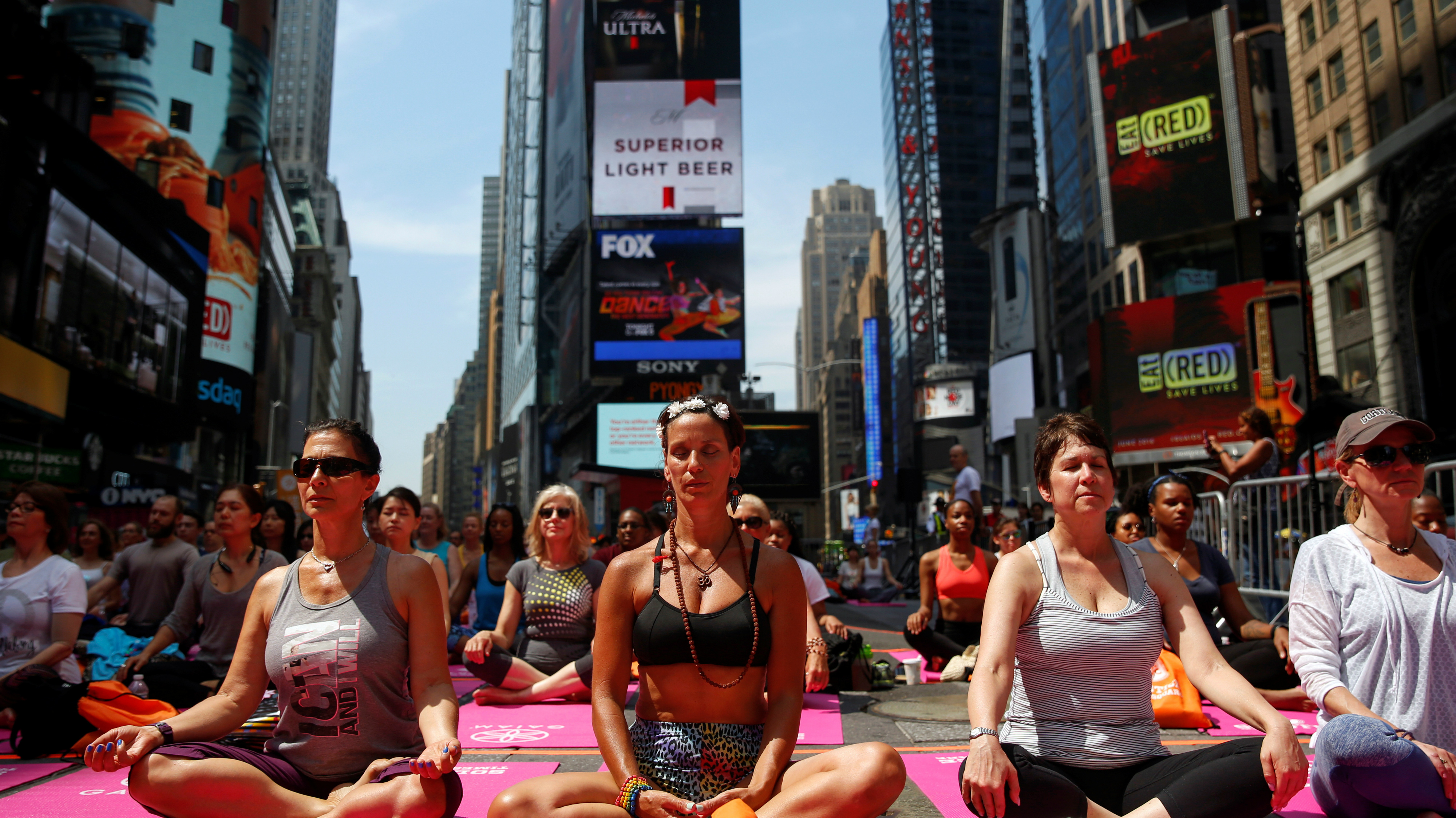 People doing Yoga in Times Square.