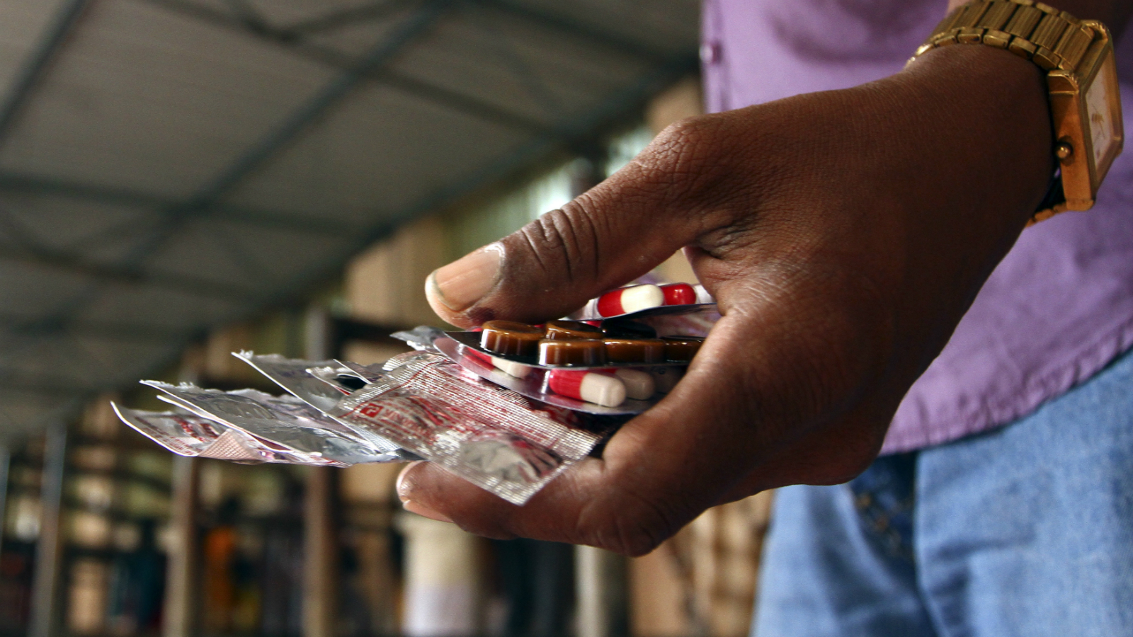 A patient holds free medicine provided by the government at Rajiv Gandhi Government General Hospital (RGGGH) in Chennai July 12, 2012. Chennai is the capital of Tamil Nadu, one of two Indian states offering free medicine for all. The state provides a glimpse of the hurdles India faces as it embarks on a programme to extend free drug coverage nationwide. Picture taken July 12, 2012. To match Analysis INDIA-DRUGS/